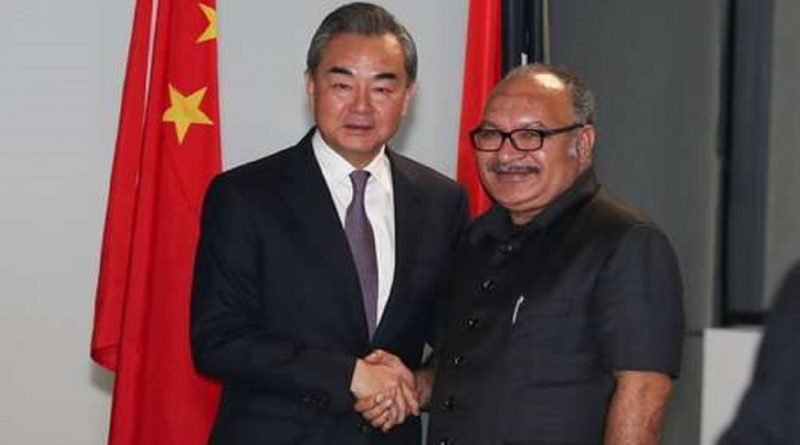 Chinese State Councilor and Foreign Minister Wang Yi meets PNG Prime Minister Peter O'Neill - China Plus