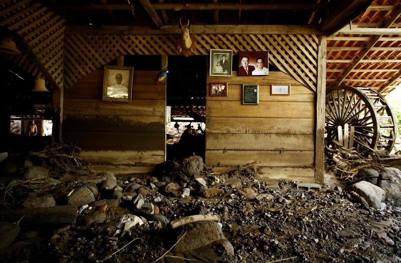 Portraits are seen on a wall of a house destroyed by a landside after Hurricane Otto hit in Guayabo de Bagaces, Costa Rica November 25, 2016. REUTERS/ Juan Carlos Ulate