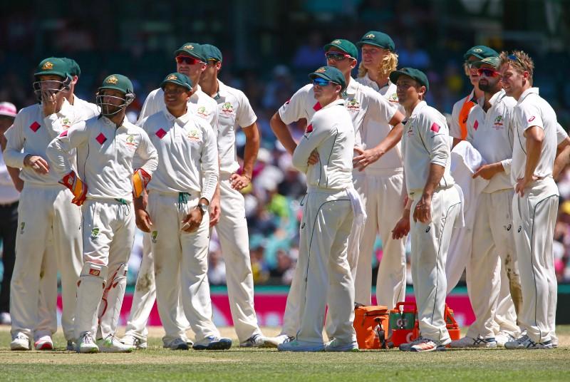 Cricket - Australia v Pakistan - Third Test cricket match - Sydney Cricket Ground, Sydney, Australia - 7/1/17 Australian players watch a replay on appeal to dismiss Pakistan's Wahab Riaz. REUTERS/David Gray