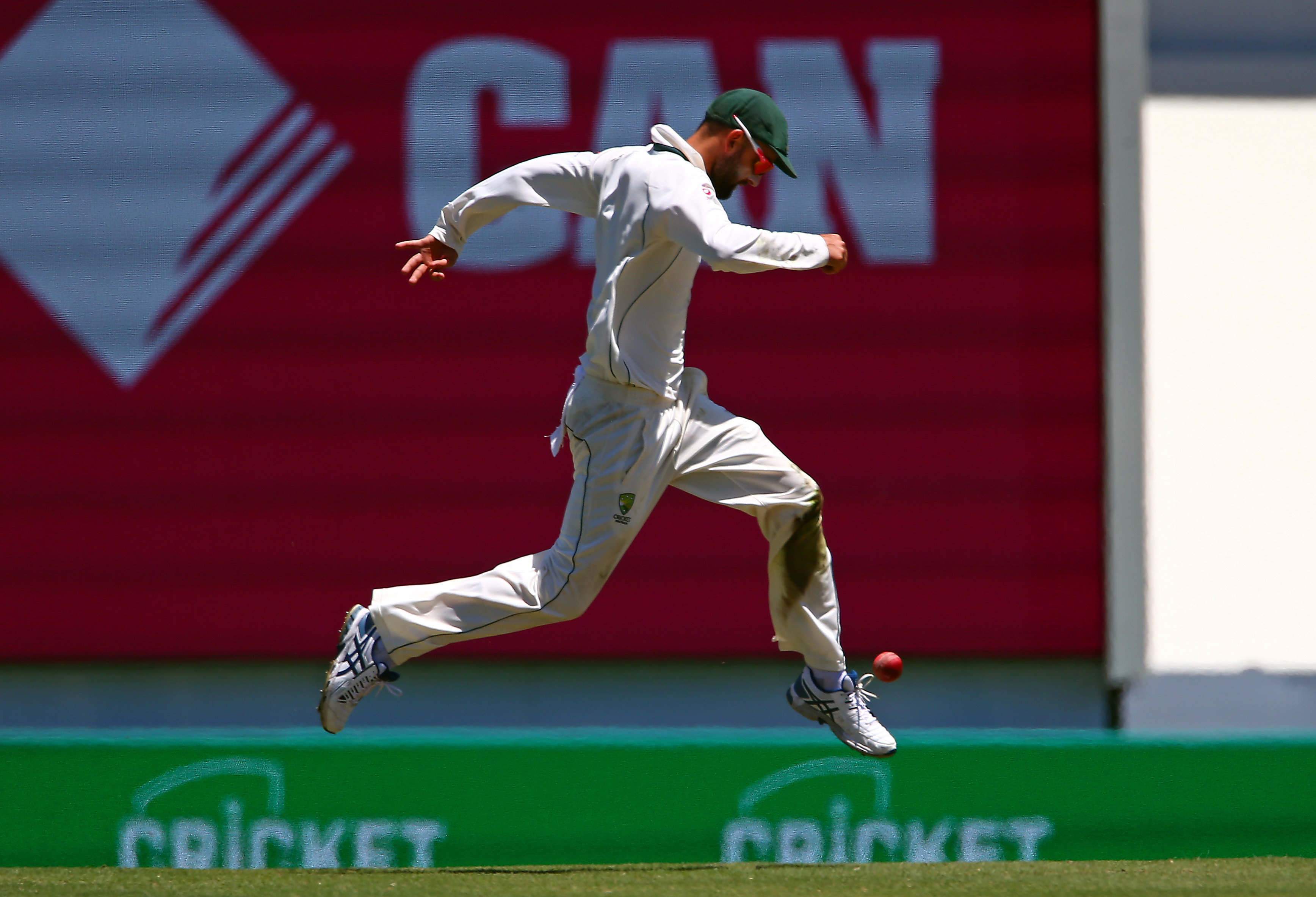 Cricket - Australia v Pakistan - Third Test cricket match - Sydney Cricket Ground, Sydney, Australia - 7/1/17 Australia's Nathan Lyon kicks the ball after it landed near him.  REUTERS/David Gray