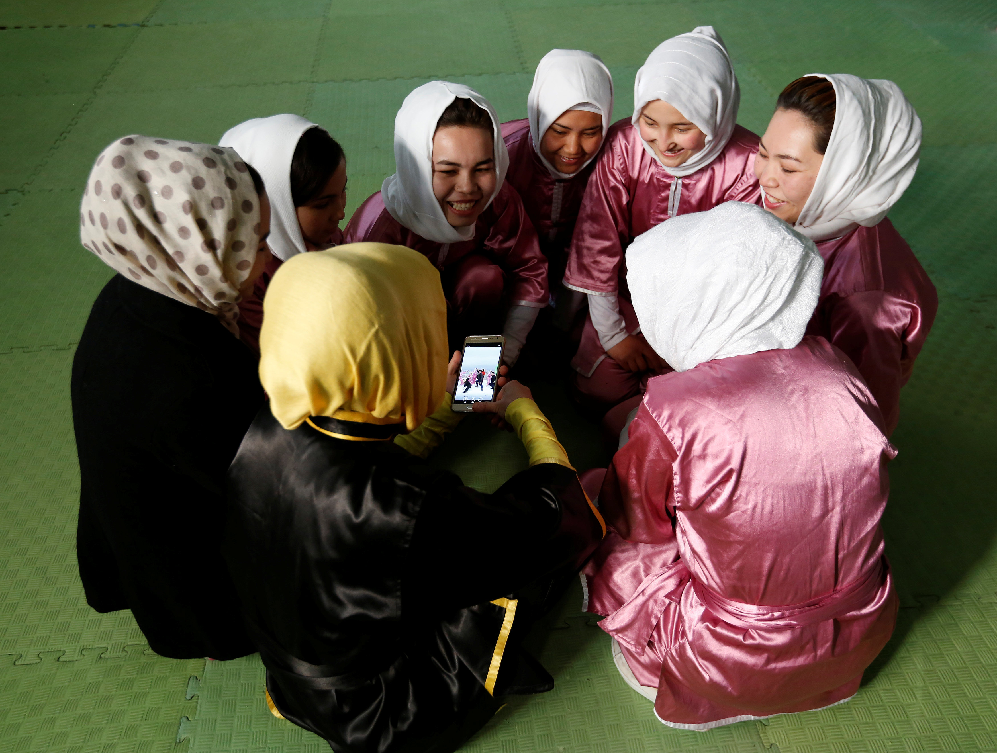 Students of the Shaolin Wushu club chat before an exercise in Kabul, Afghanistan January 19, 2017. REUTERS/Mohammad Ismail