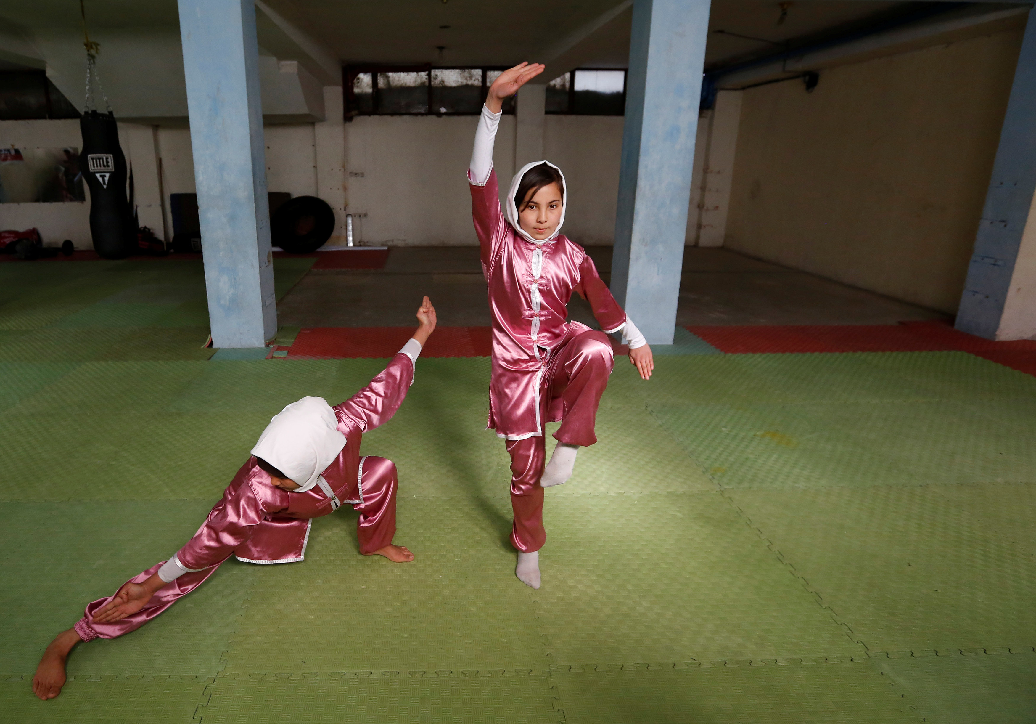Mena Azimi (R), 15, practices at the Shaolin Wushu club in Kabul, Afghanistan January 19, 2017. REUTERS/Mohammad Ismail