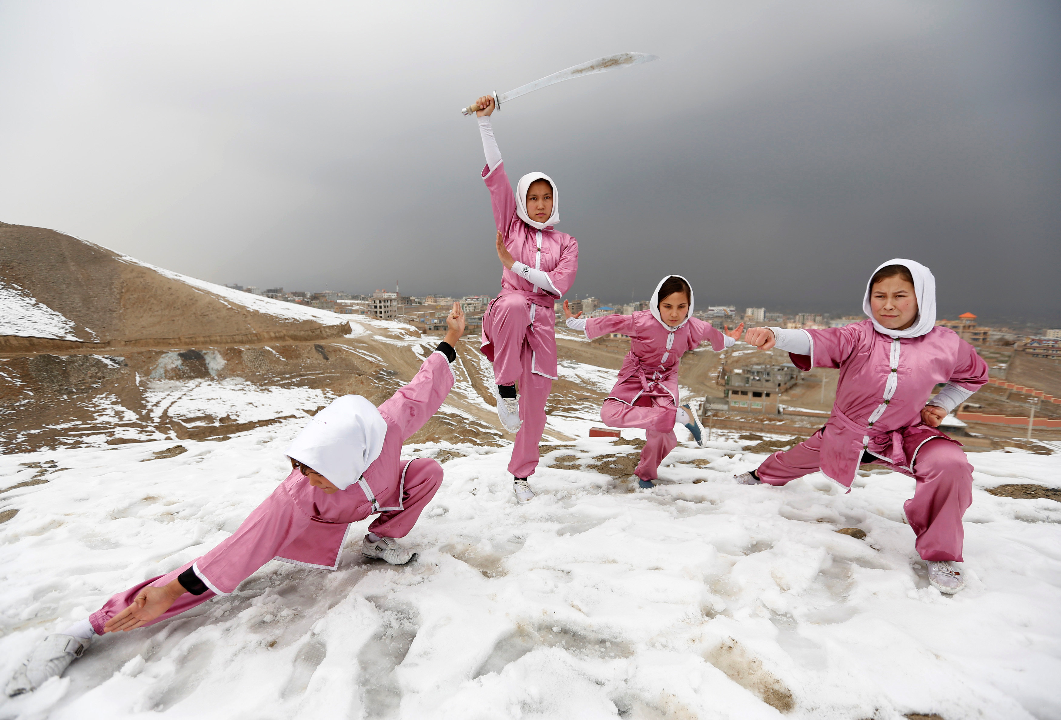 Hanifa Doosti (C), 17,  and other students of the Shaolin Wushu club show their Wushu skills to other students on a hilltop in Kabul, Afghanistan January 29, 2017. REUTERS/Mohammad Ismail