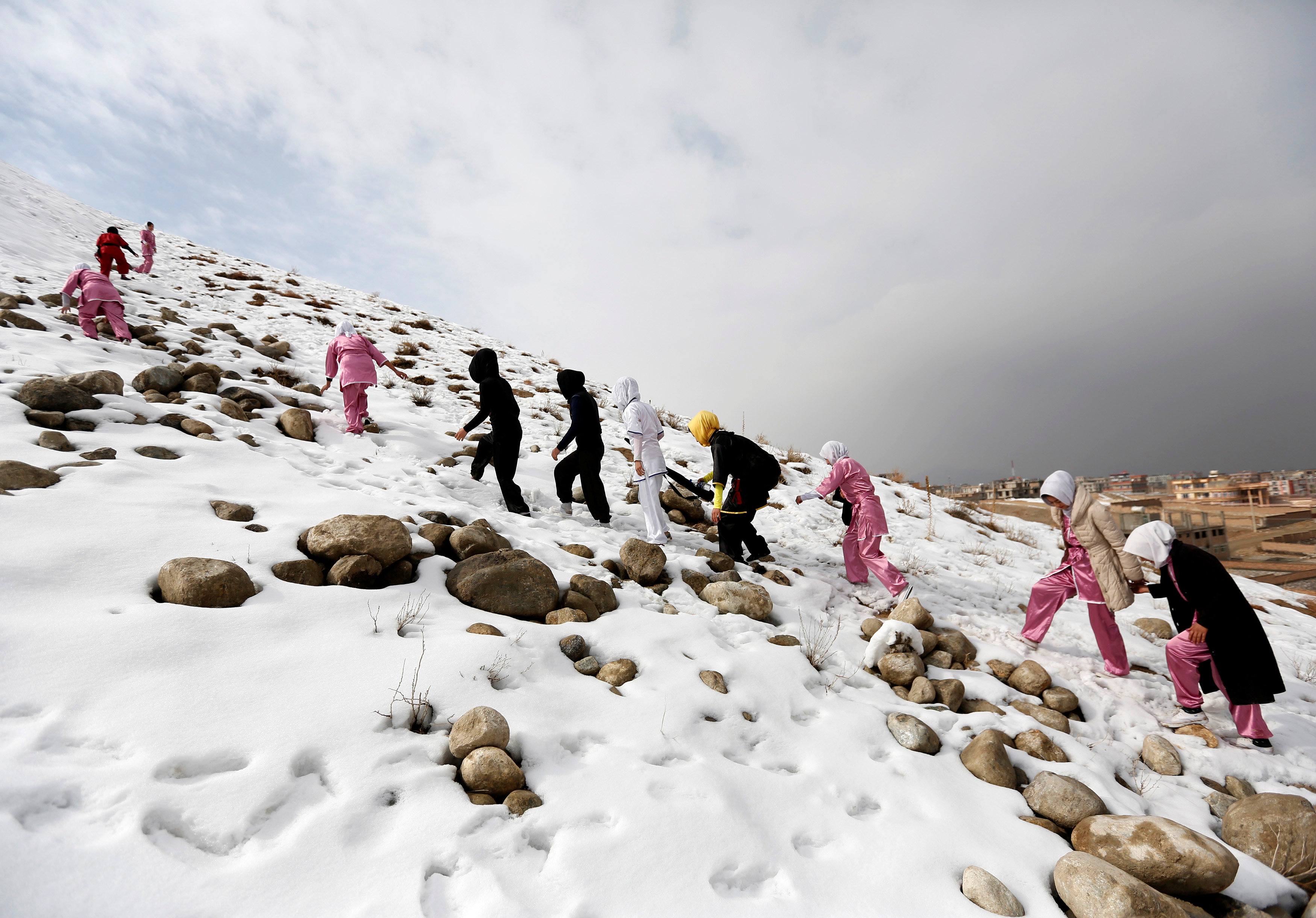 Students of the Shaolin Wushu club climb a hill as they arrive to practice in Kabul, Afghanistan January 29, 2017. REUTERS/Mohammad Ismail
