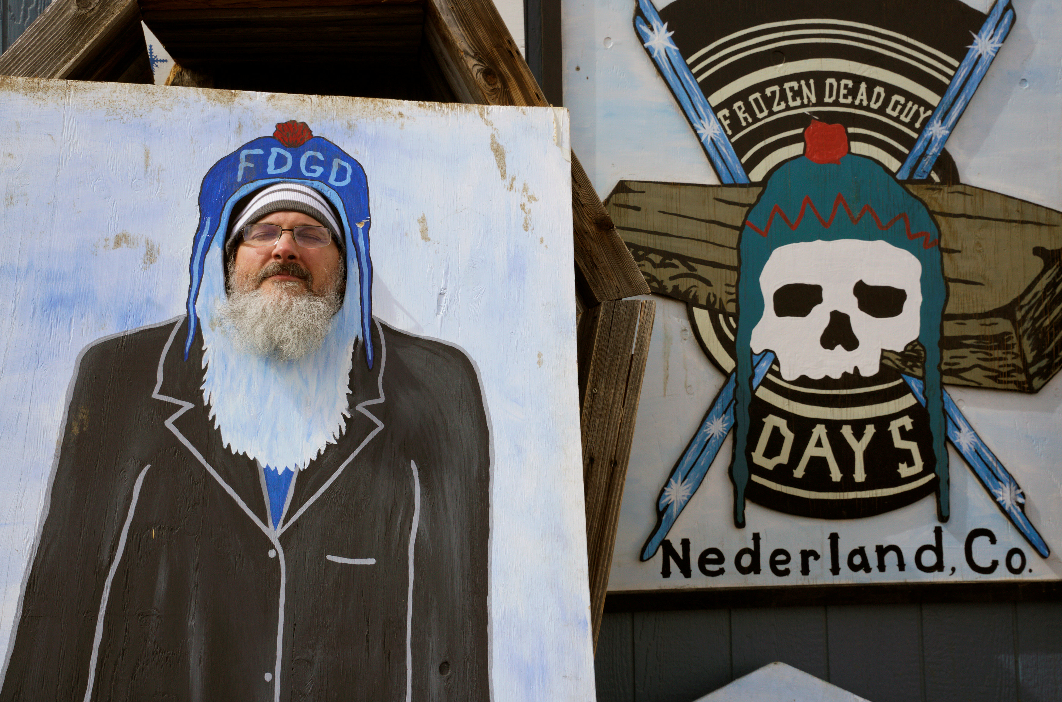 """Kevin Weller poses in a cutout of the frozen corpse that inspired the annual """"Frozen Dead Guy Days"""" festival in Nederland, Colorado, U.S., March 11, 2017. REUTERS/Rick Wilking"""