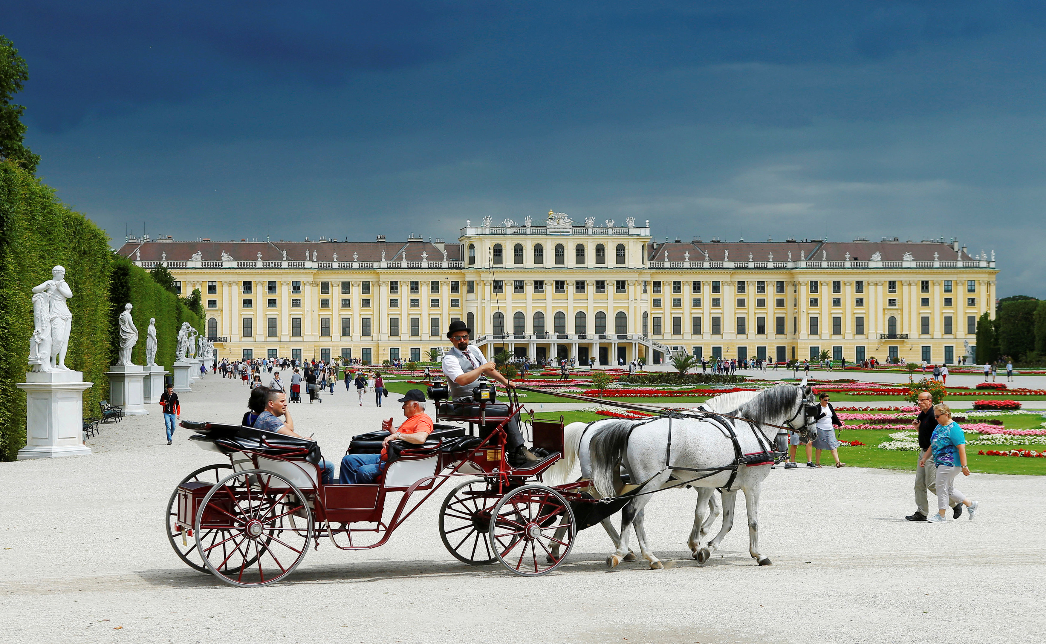 FILE PHOTO: A traditional Fiaker horse carriage passes imperial Schoenbrunn palace in Vienna, Austria, June 14, 2016. REUTERS/Heinz-Peter Bader/File Photo