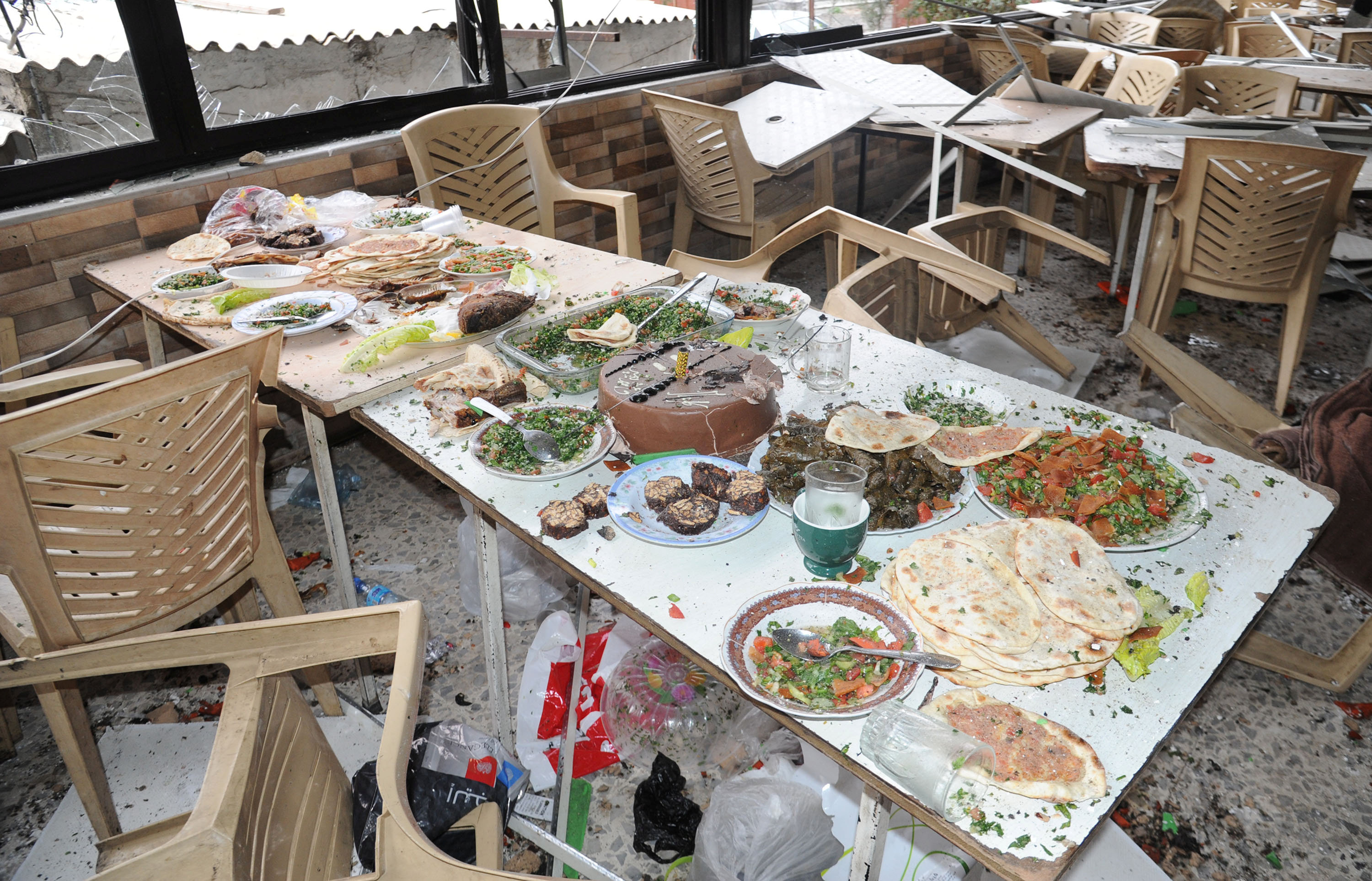 Damage is seen after a suicide attack inside a restaurant in the al-Rabweh area of Damascus in this handout picture provided by SANA on March 15, 2017, Syria.  SANA/Handout via REUTERS