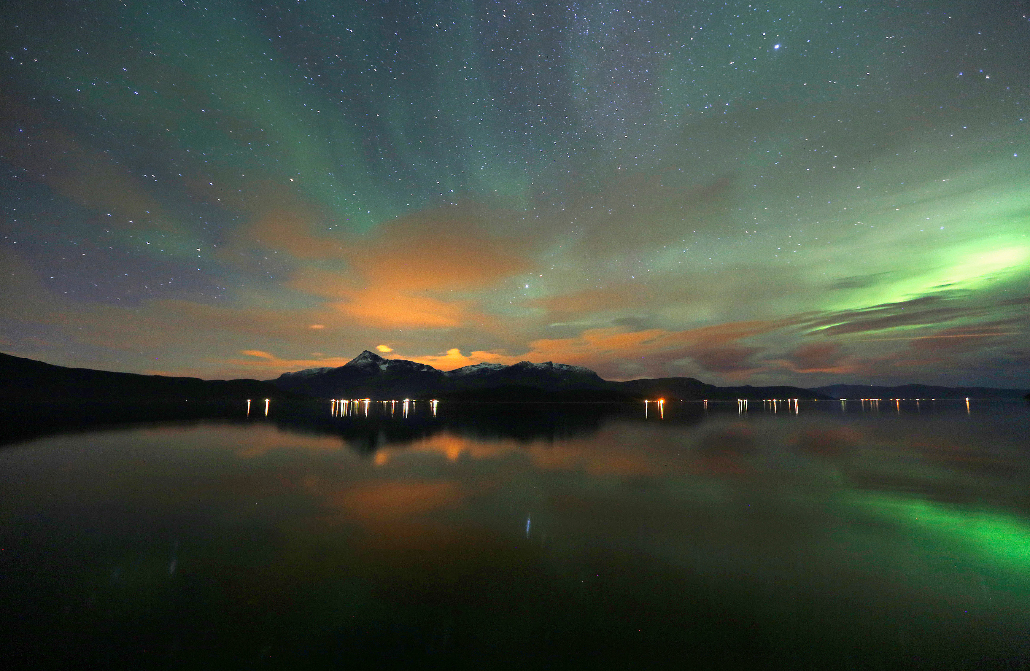 FILE PHOTO - The Aurora Borealis (Northern Lights) is seen over the Bals-Fiord near the village of Mestervik, north of the Arctic Circle, early October 2, 2014.  REUTERS/Yannis Behrakis/File Photo