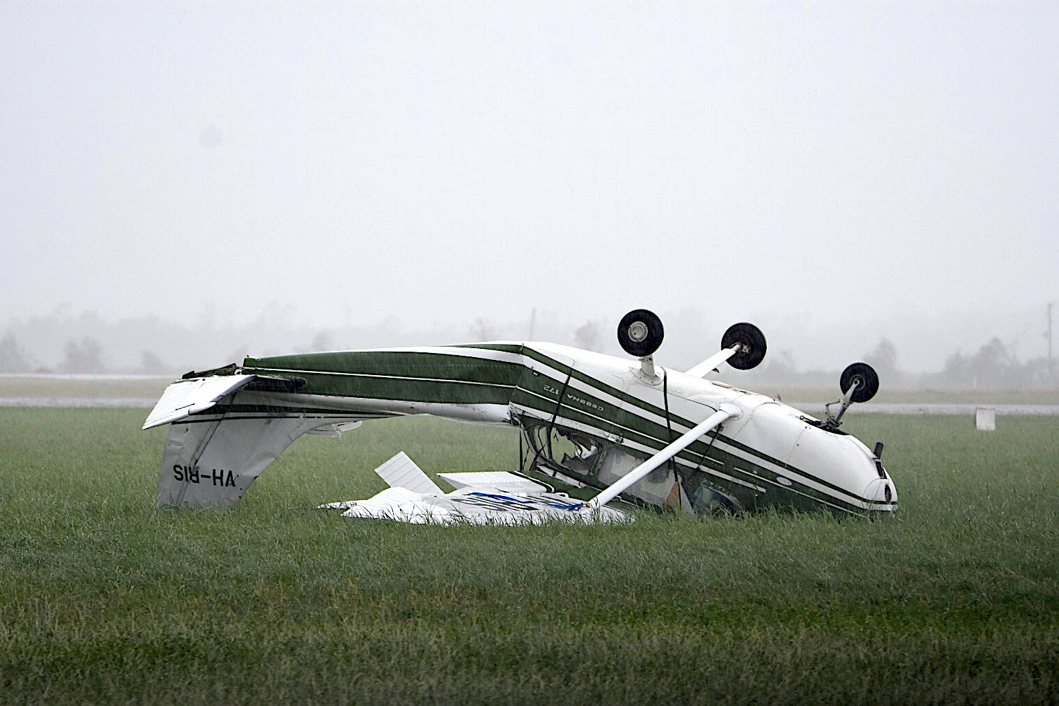 A plane that was flipped by strong winds from Cyclone Debbie is seen at the airport in the town of Bowen, located south of the northern Australian city of Townsville, March 29, 2017.    AAP/Sarah Motherwell/via REUTERS