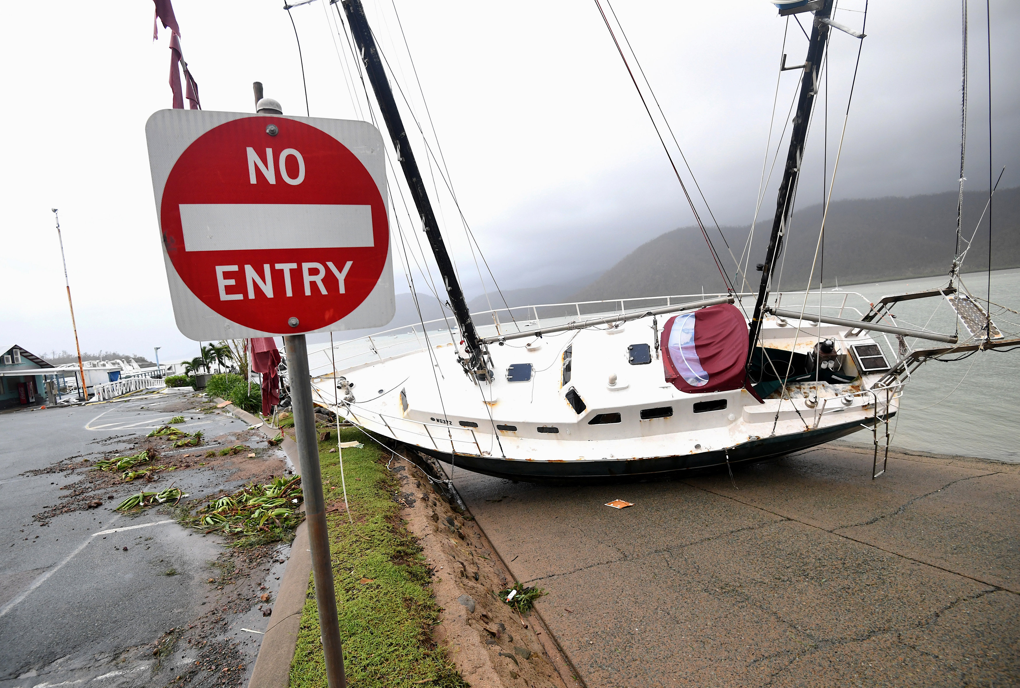 A boat is seen smashed against the bank at Shute Harbour, Airlie Beach, Wednesday, March 29, 2017. Cyclone Debbie has hit Queensland's far north coast yesterday as a category 4 cyclone, causing wide spread damage. AAP/Dan Peled/via REUTERS