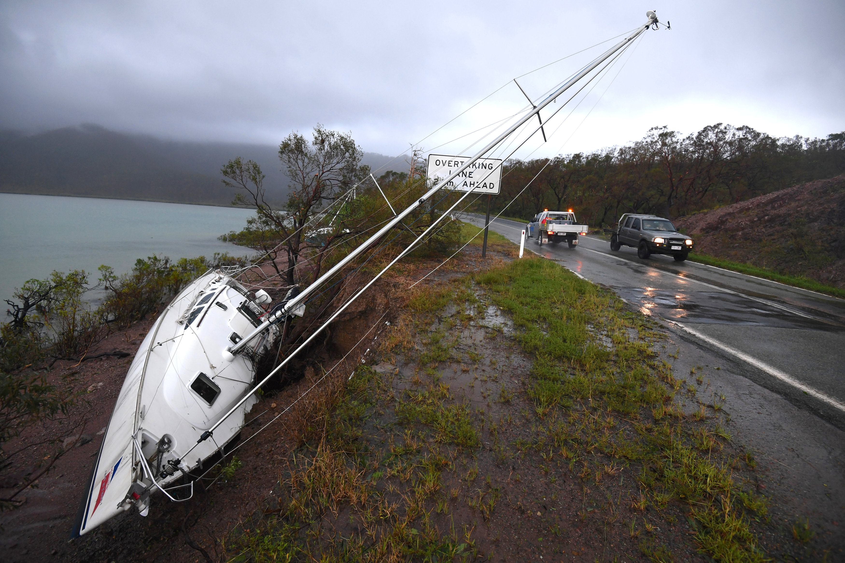 A yacht lies beside a road after Cyclone Debbie hit the northern Queensland town of Airlie Beach, located south of Townsville in Australia, March 29, 2017.   AAP/Dan Peled/via REUTERS