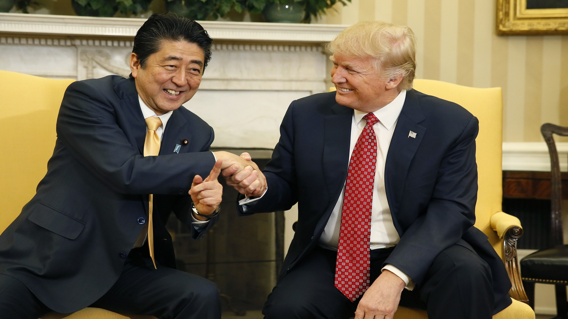 Japanese Prime Minister Abe Shakes Hands With Us President Trump