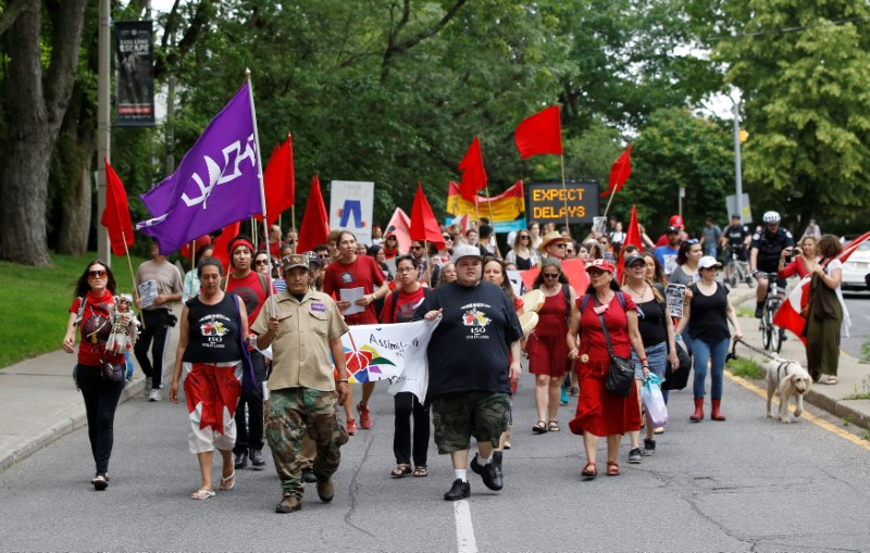 """Indigenous rights activists march after in the """"Unsettle Canada Day 150 Picnic"""", as the country marks its 150th anniversary with """"Canada 150"""" celebrations, in Toronto, Ontario, Canada July 1, 2017.    REUTERS/Mark Blinch"""