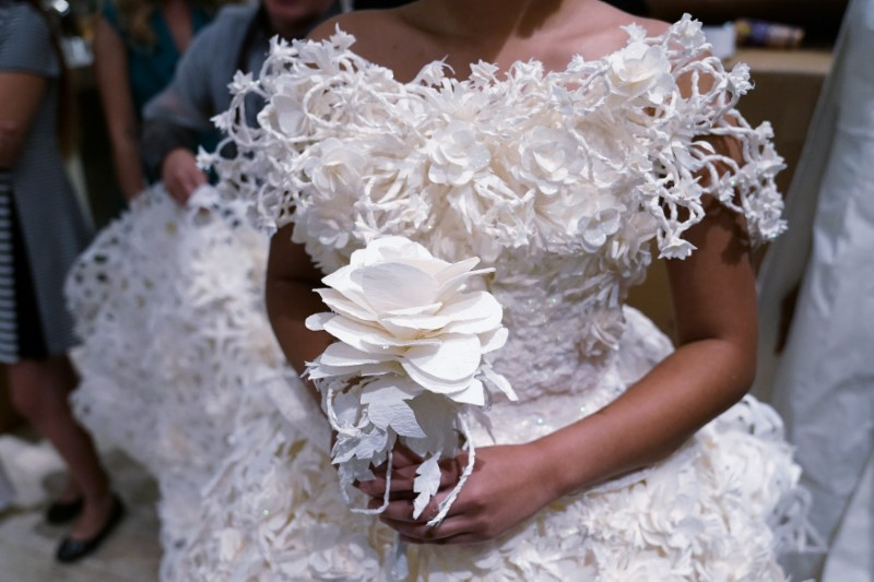 A model is pictured backstage wearing a wedding dress made out of toilet paper before a fashion show in the Manhattan borough of New York City, New York, U.S. July 20, 2017.  REUTERS/Carlo Allegri