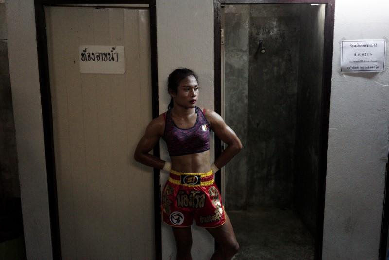 Muay Thai boxer Nong Rose Baan Charoensuk, 21, who is transgender, waits before her boxing match at the Rajadamnern Stadium in Bangkok, Thailand, July 13, 2017. REUTERS/Athit Perawongmetha
