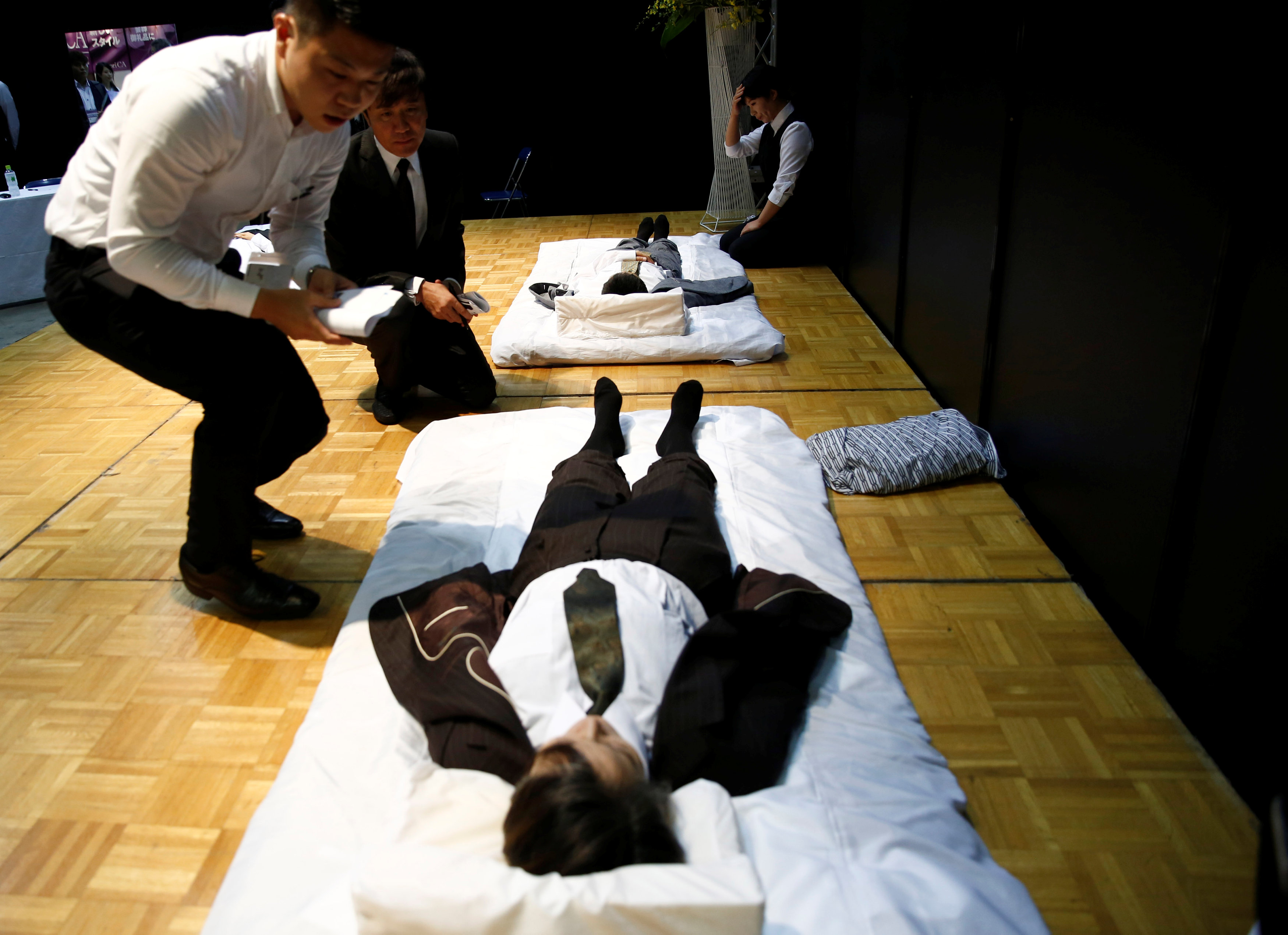 Judges check a model after a funeral undertaker dressed up the model, during an encoffinment competition at Life Ending Industry EXPO 2017 in Tokyo, Japan August 24, 2017. REUTERS/Kim Kyung-Hoon