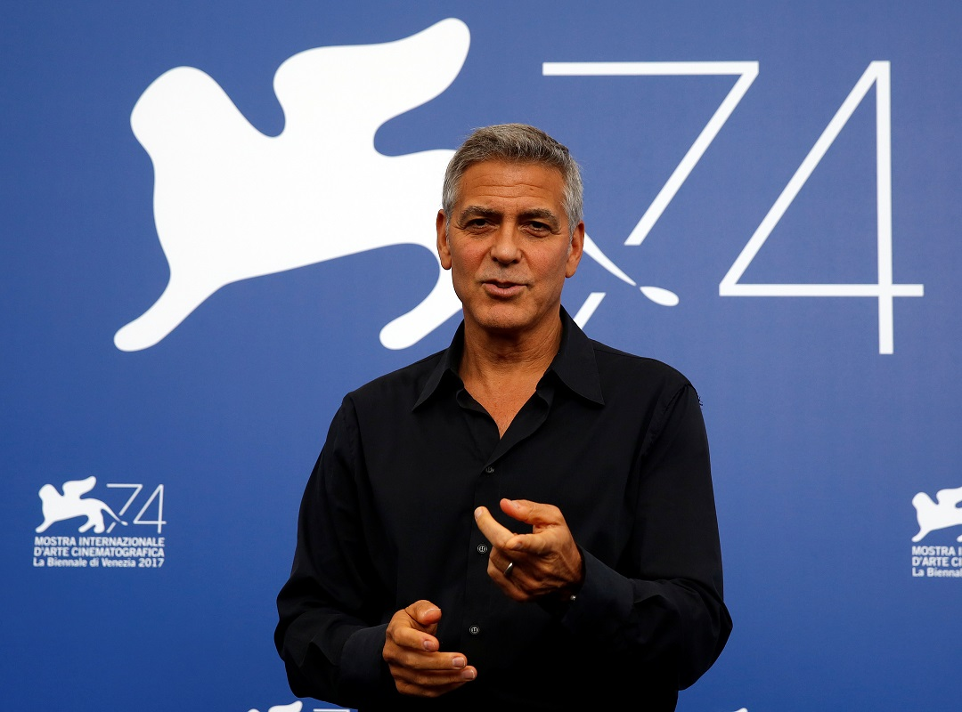 """Actor and director George Clooney gestures during a photocall for the movie """"Suburbicon"""" at the 74th Venice Film Festival in Venice, Italy September 2, 2017. REUTERS/Alessandro Bianchi/Files"""