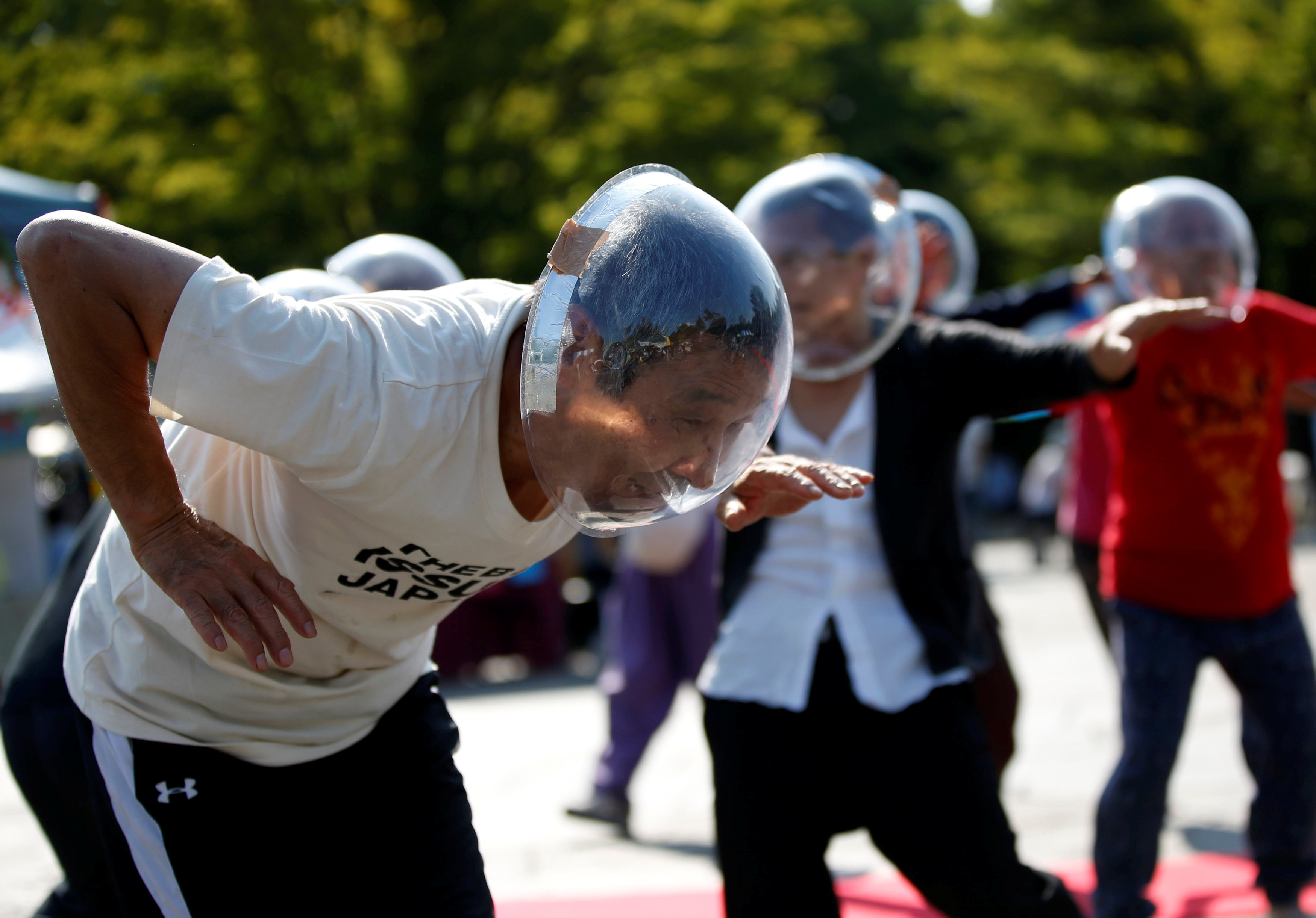 """Masayoshi Koiso (L), a 69-year-old homeless man and a member of Newcomer """"H"""" Sokerissa! - a group of current and former homeless dancers, performs at a park in Tokyo, Japan, September 9, 2017. Picture taken September 9, 2017. REUTERS/Toru Hanai"""