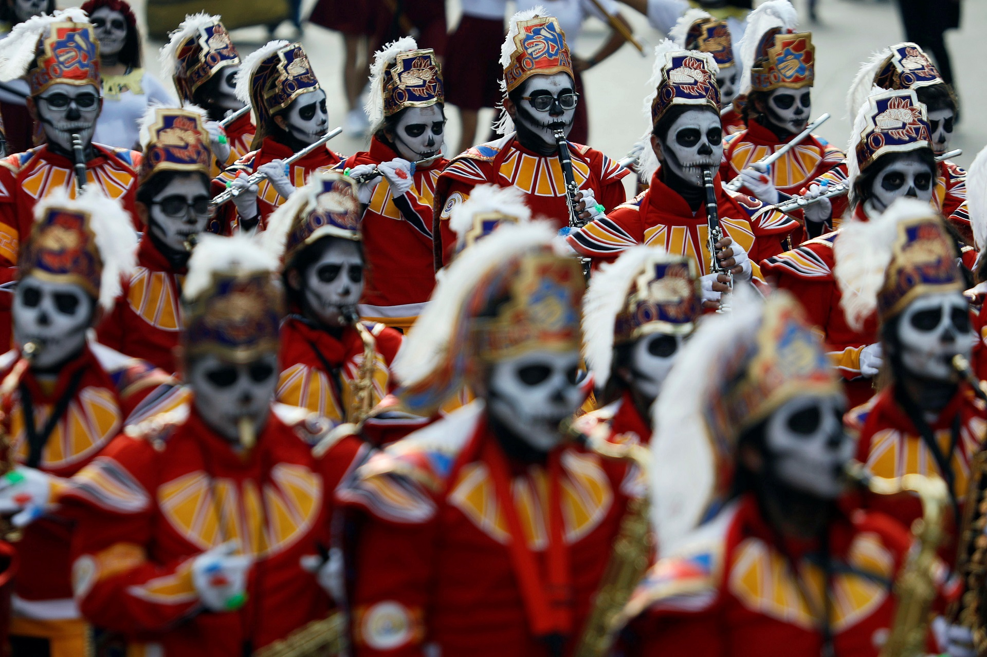 "Musicians dressed up as a ""Catrines"", a Mexican character also known as ""The Elegant Death"", participate in a procession to commemorate Day of the Dead in Mexico City, Mexico, October 28, 2017. REUTERS/Edgard Garrido"