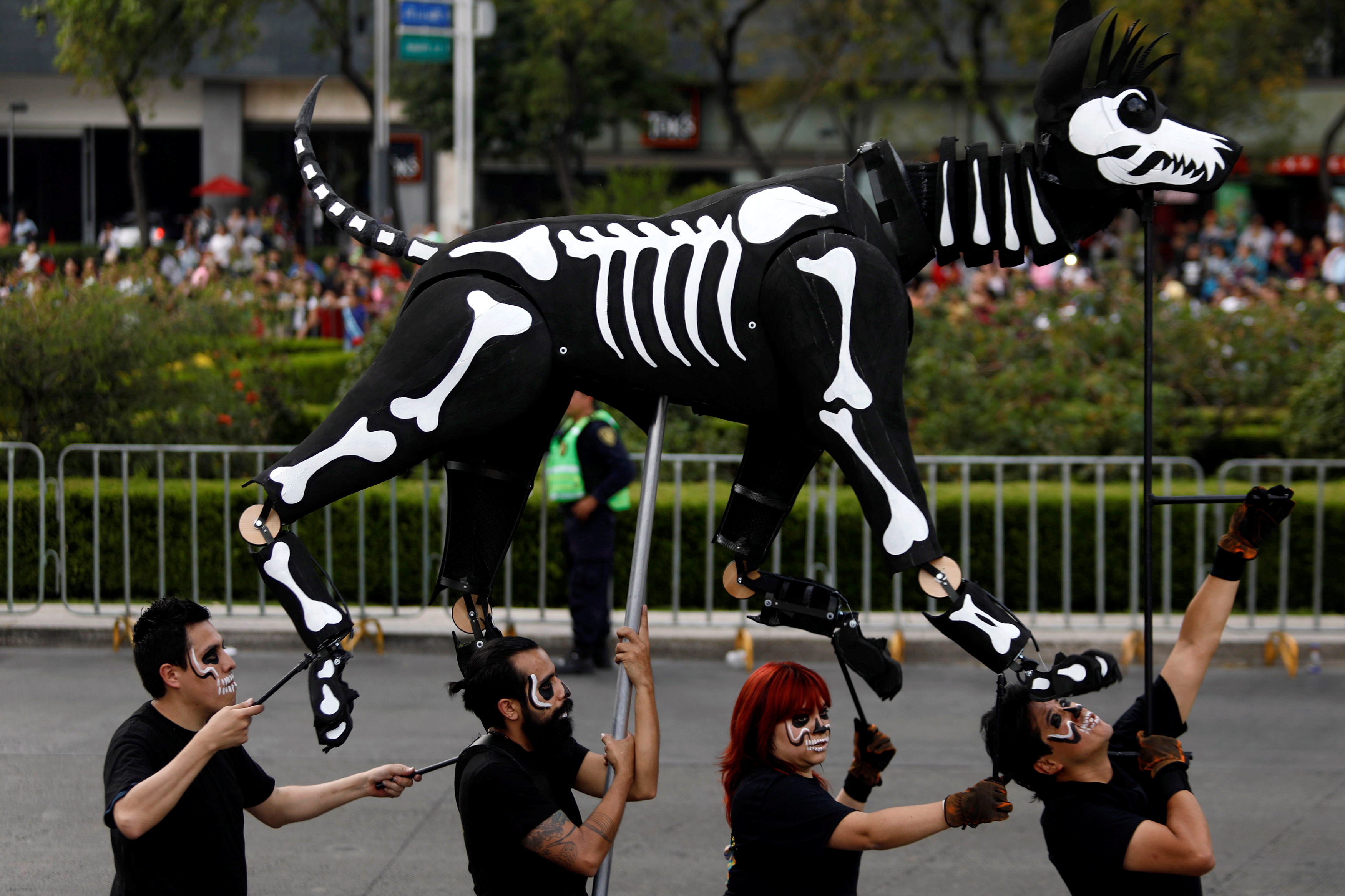 A puppet depicting the skeleton of a dog participates in a procession to commemorate Day of the Dead in Mexico City, Mexico, October 28, 2017. REUTERS/Edgard Garrido