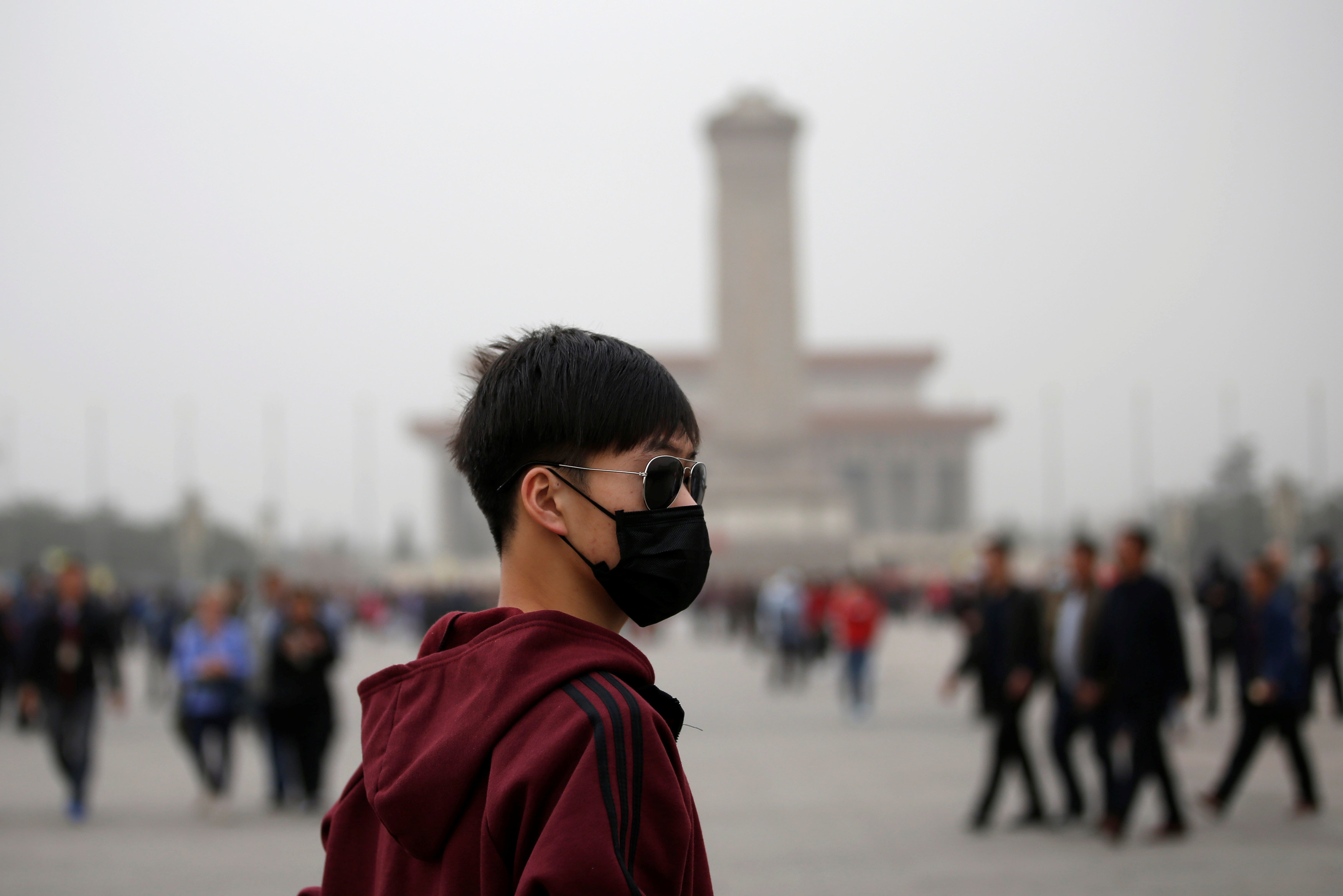 A man wearing a mask visits at Tiananmen Square as a dust storm hits Beijing, China March 28, 2018. REUTERS/Jason Lee
