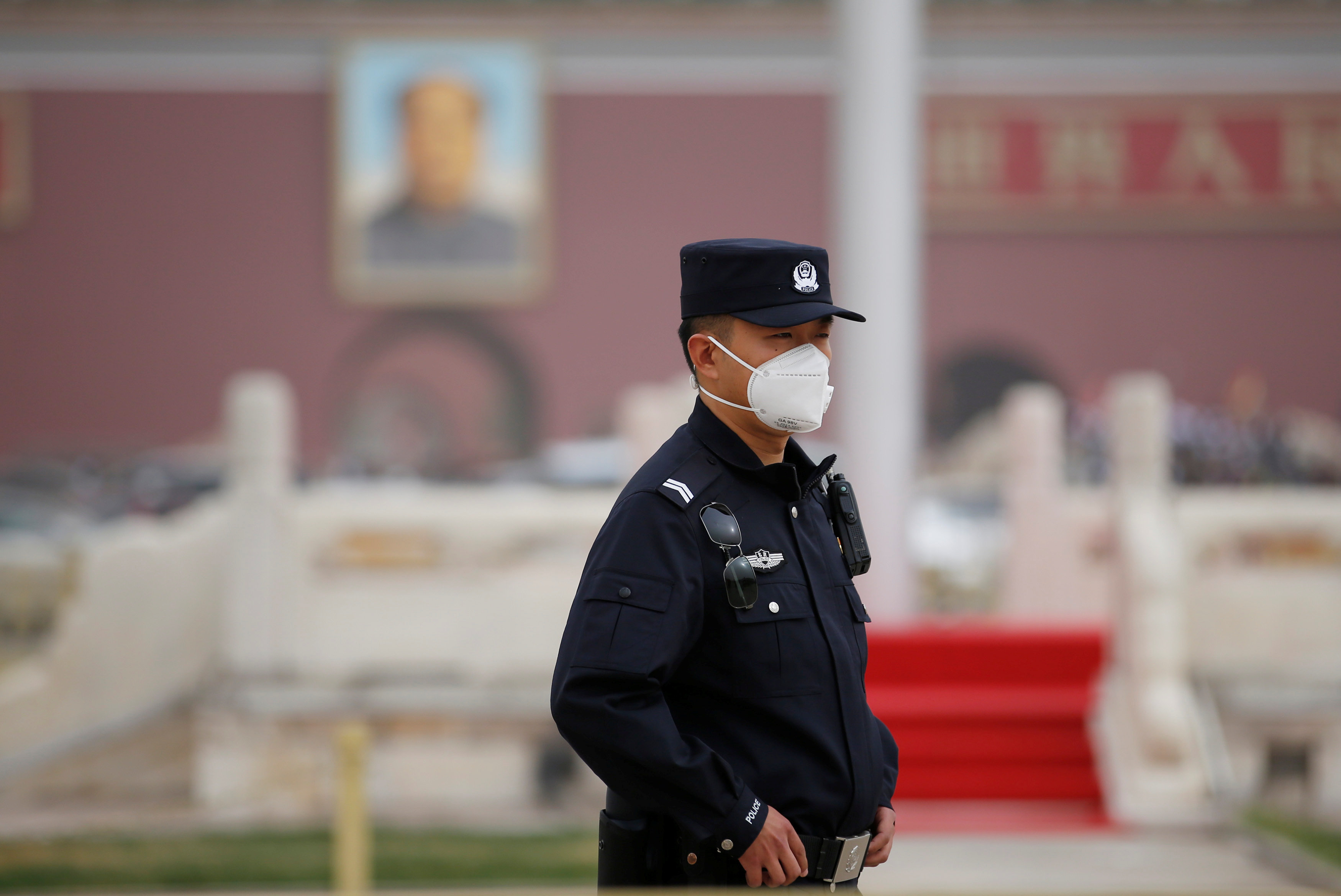 A policeman wearing a mask keeps watch at Tiananmen Square as a dust storm hits Beijing, China March 28, 2018. REUTERS/Jason Lee