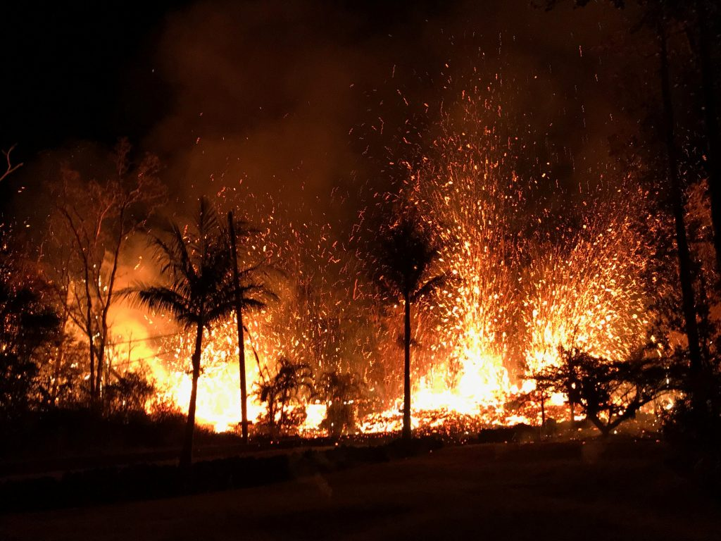 A new fissure spraying lava fountains as high as about 230 feet (70 m), according to United States Geological Survey, is shown from Luana Street in Leilani Estates subdivision on Kilauea Volcano's lower East Rift Zone in Hawaii, U.S., May 5, 2018.  Photo taken May 5, 2018.  US Geological Survey/Handout via REUTERS