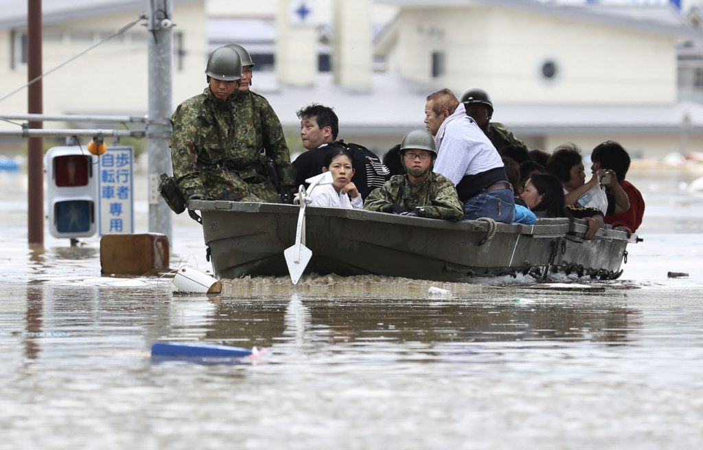 Residents are rescued from a flooded area by Japan Self-Defense Force soldiers in Kurashiki, southern Japan, in this photo taken by Kyodo July 7, 2018. Mandatory credit Kyodo/via REUTERS