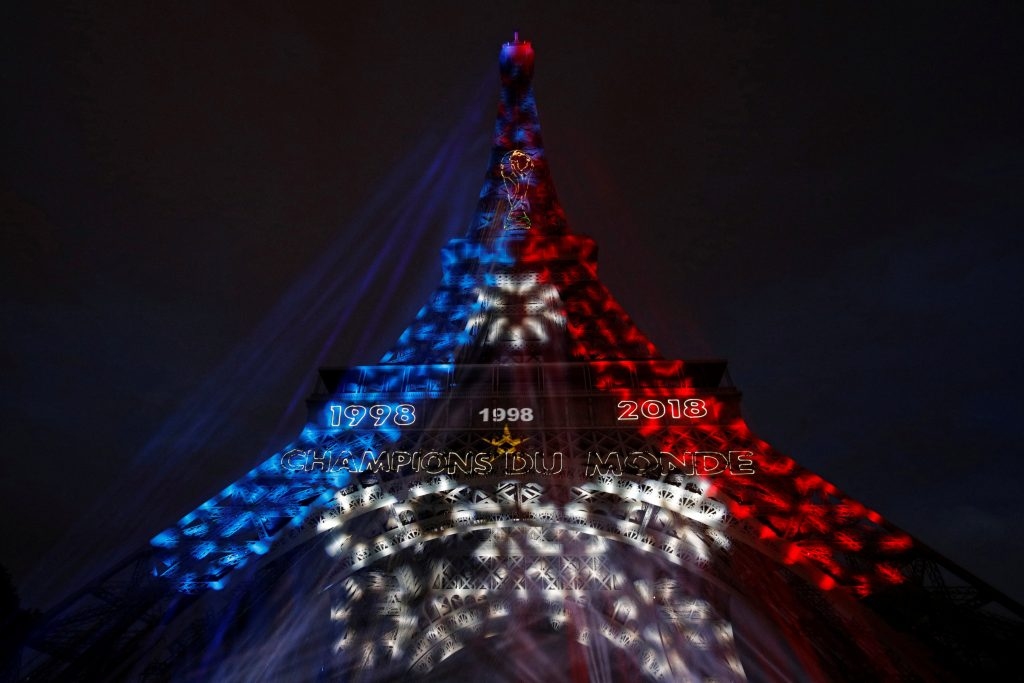Soccer Football - World Cup - Final - France vs Croatia - Paris, France, July 15, 2018 - Blue, White, and Red lights and two World Cup stars are projected on the Eiffel Tower after France won the Soccer World Cup final.   REUTERS/Philippe Wojazer