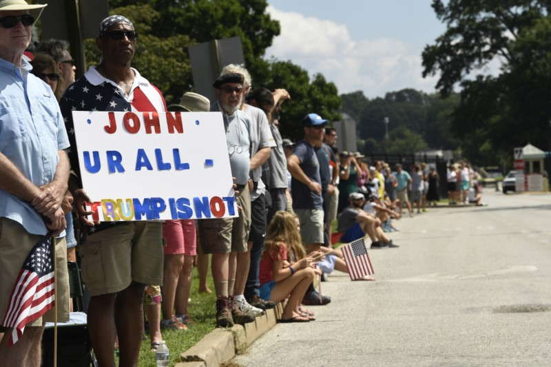 Aug 12, 2018; Annapolis, MD, USA; People gather to watch the passing of John McCain's motorcade on his way to be laid to rest at the U.S. Naval Academy. Mandatory Credit: Jasper Colt via USA TODAY NETWORK