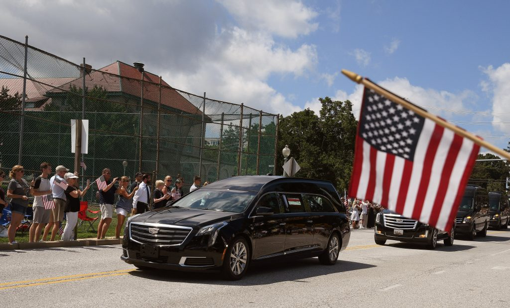 A hearse containing the body of the late Senator John McCain arrives for a private memorial service and burial at the U.S. Naval Academy in Annapolis, U.S., September 2, 2018. REUTERS/Mary F. Calvert