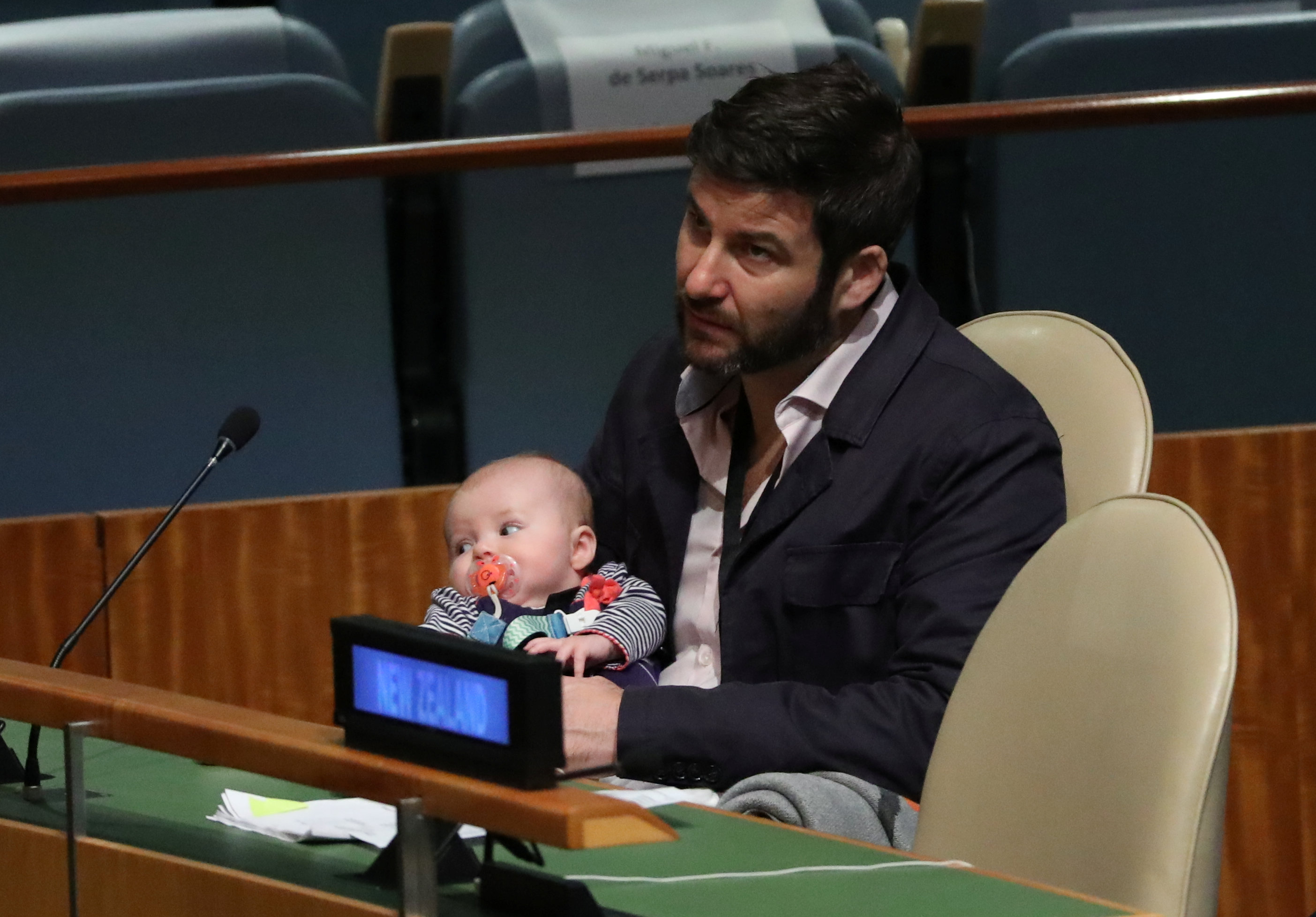 Clarke Gayford, partner to New Zealand Prime Minister Jacinda Ardern holds their baby Neve as Ardern speaks at the Nelson Mandela Peace Summit during the 73rd United Nations General Assembly in New York, U.S., September 24, 2018. REUTERS/Carlo Allegri