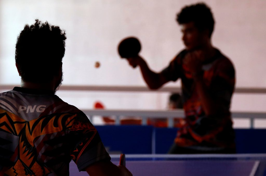 Papua New Guinea table tennis players Gasika Sepa and David Thomas play on a table during a practice session at a Beijing-funded facility in central Port Moresby in Papua New Guinea, November 19, 2018. Picture taken November 19, 2018.   REUTERS/David Gray
