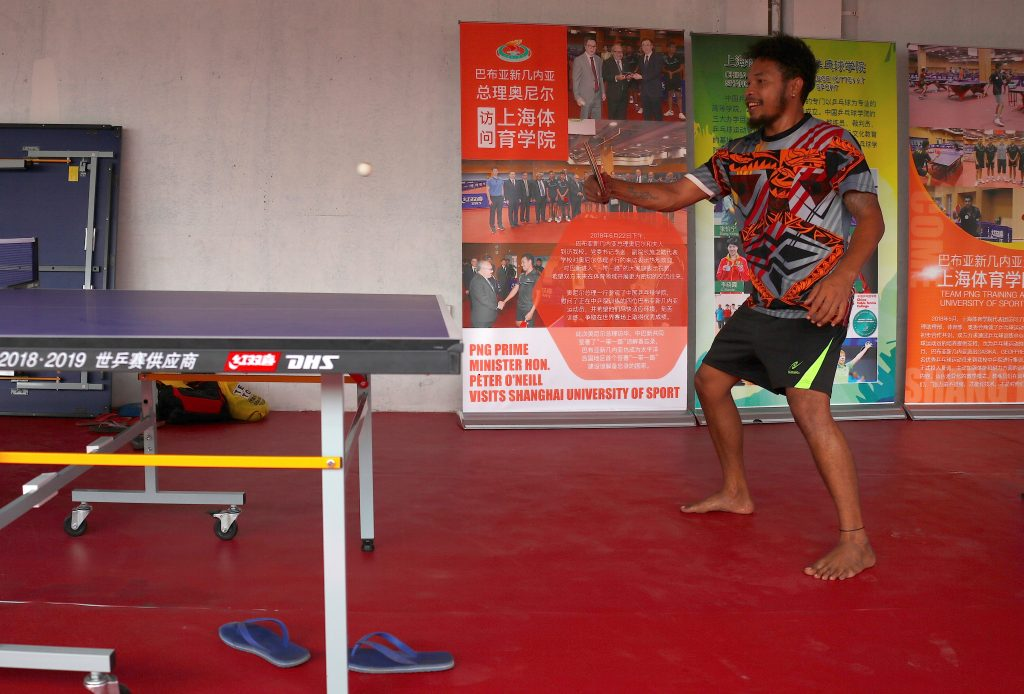 Papua New Guinea table tennis player Gasika Sepa practices in front of promotional posters at a Beijing-funded facility in central Port Moresby in Papua New Guinea, November 19, 2018. Picture taken November 19, 2018.   REUTERS/David Gray