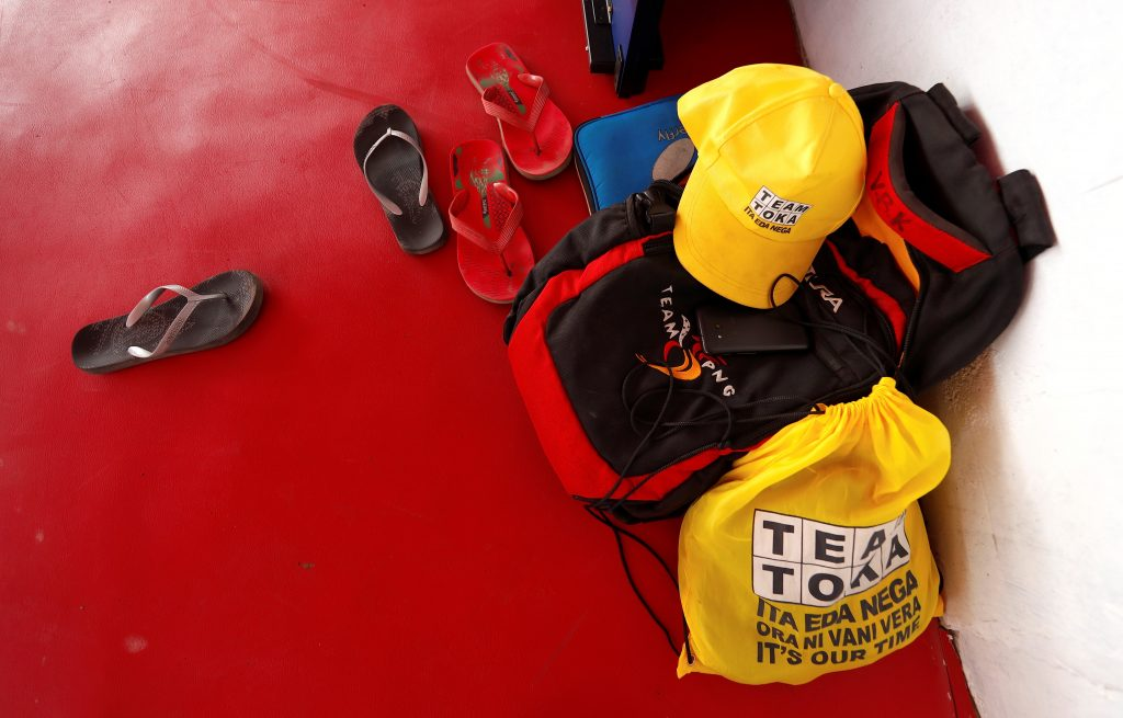 The bags, hats and flip flops of Papua New Guinea table tennis players can be seen against a wall during a practice session at a Beijing-funded facility in central Port Moresby in Papua New Guinea, November 19, 2018. Picture taken November 19, 2018.   REUTERS/David Gray