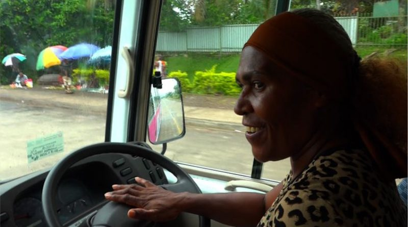 Barbra Namuesh takes charge of a Meri Seif Bus in Lae