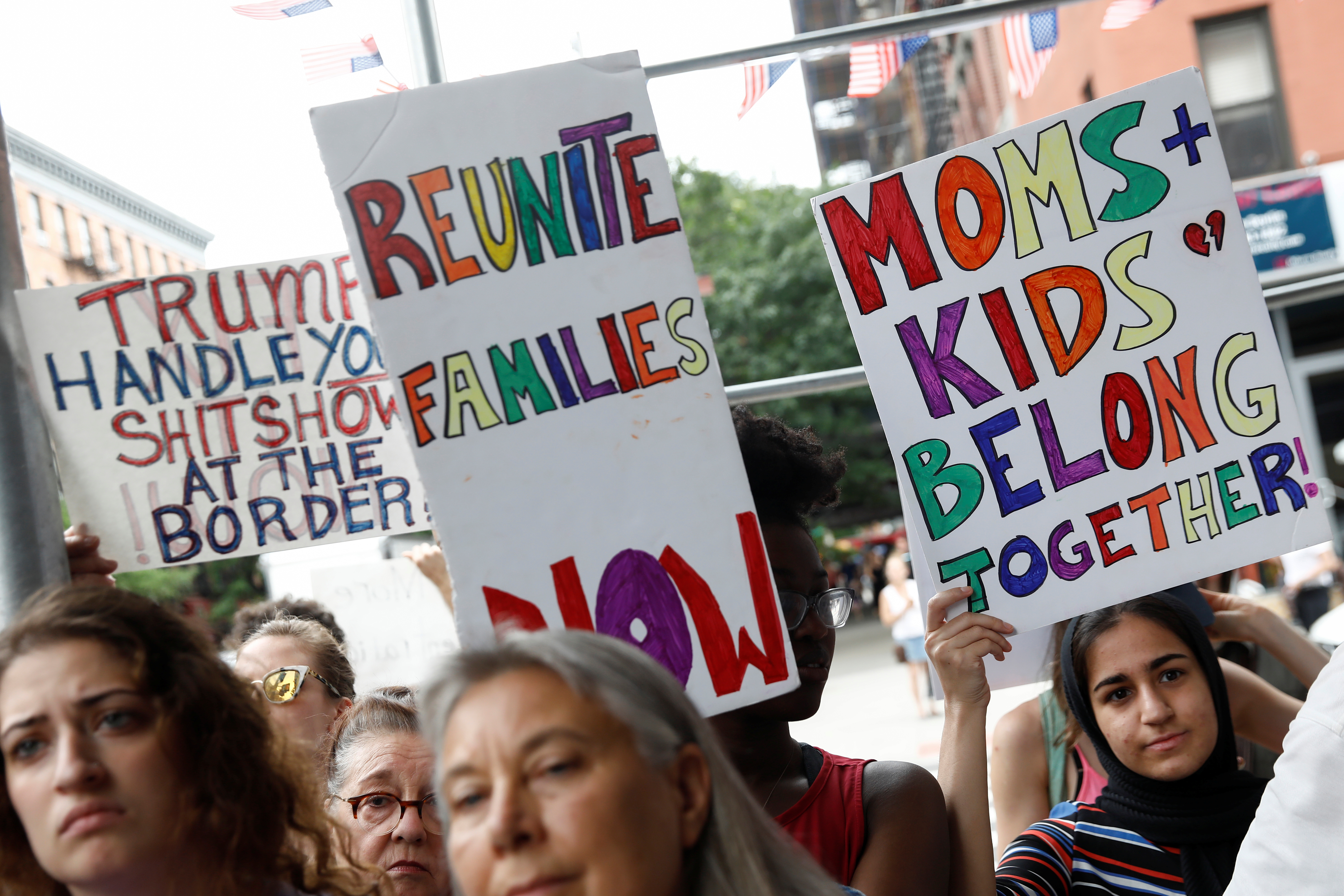 Demonstrators hold signs during a 'Close the Camps' rally to demand the closure of inhumane immigrant detention centers outside the Middle Collegiate Church in New York, U.S., July 2, 2019.  REUTERS/Shannon Stapleton