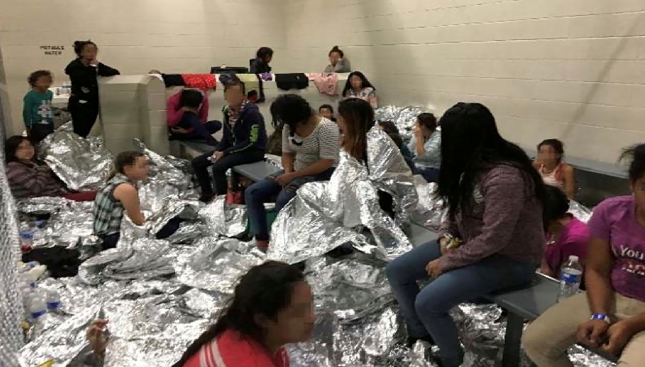 An overcrowded area holding families at a Border Patrol Centralized Processing Center is seen in a still image from video in McAllen, Texas, U.S. on June 11, 2019 and released as part of a report by the Department of Homeland Security's Office of Inspector General on July 2, 2019. Picture pixelated at source. Office of Inspector General/DHS/Handout via REUTERS