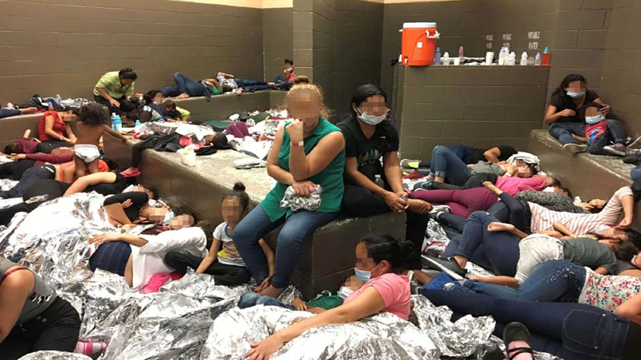 An overcrowded area holding families at a Border Patrol station is seen in a still image from video in Weslaco, Texas, U.S. on June 11, 2019 and released as part of a report by the Department of Homeland Security's Office of Inspector General on July 2, 2019. Picture pixelated at source. Office of Inspector General/DHS/Handout via REUTERS