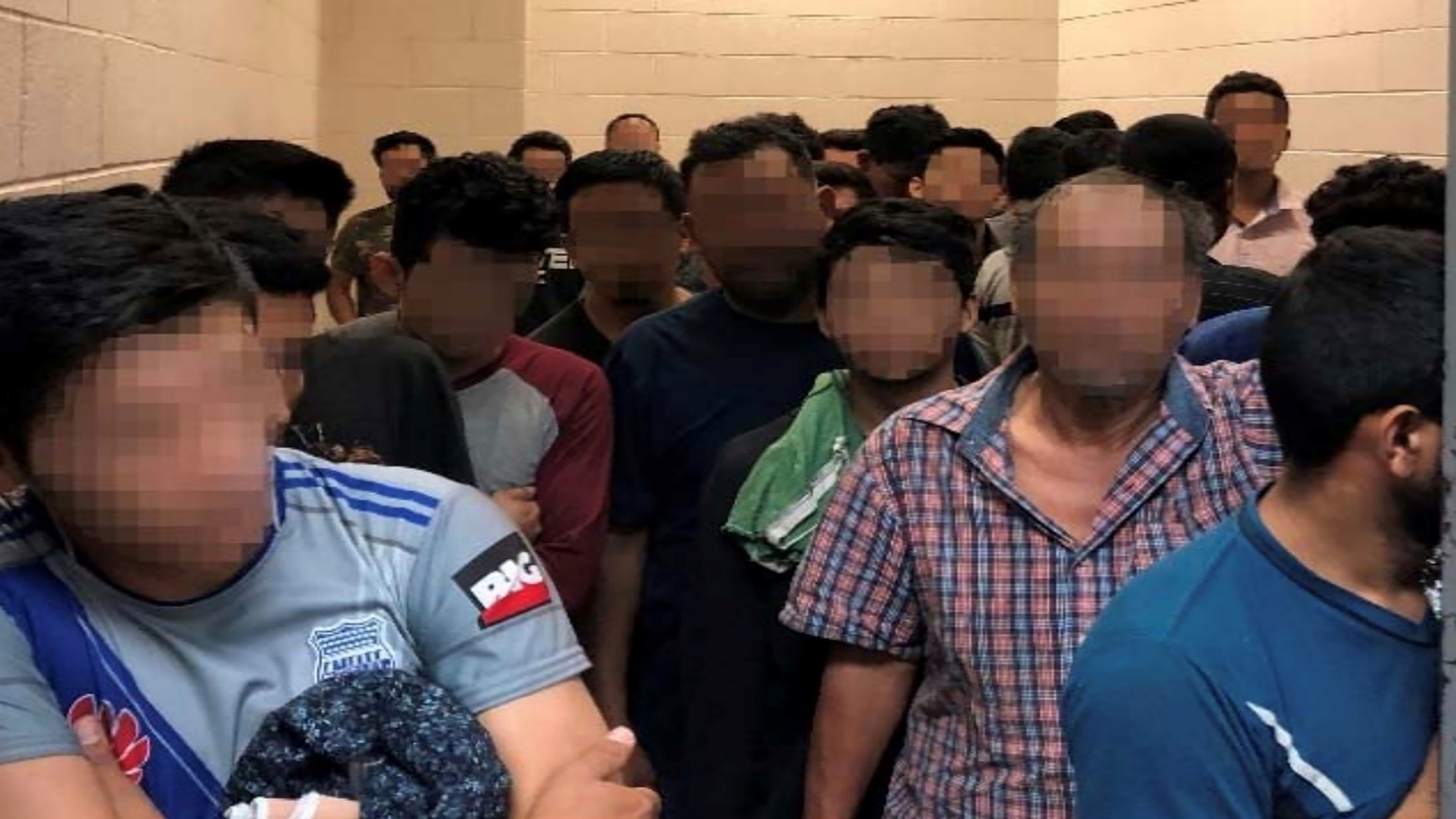 Men are crowded in a room at a Border Patrol station in a still image from video in McAllen, Texas, U.S. on June 10, 2019 and released as part of a report by the Department of Homeland Security's Office of Inspector General on July 2, 2019. Picture pixelated at source. Office of Inspector General/DHS/Handout via REUTERS