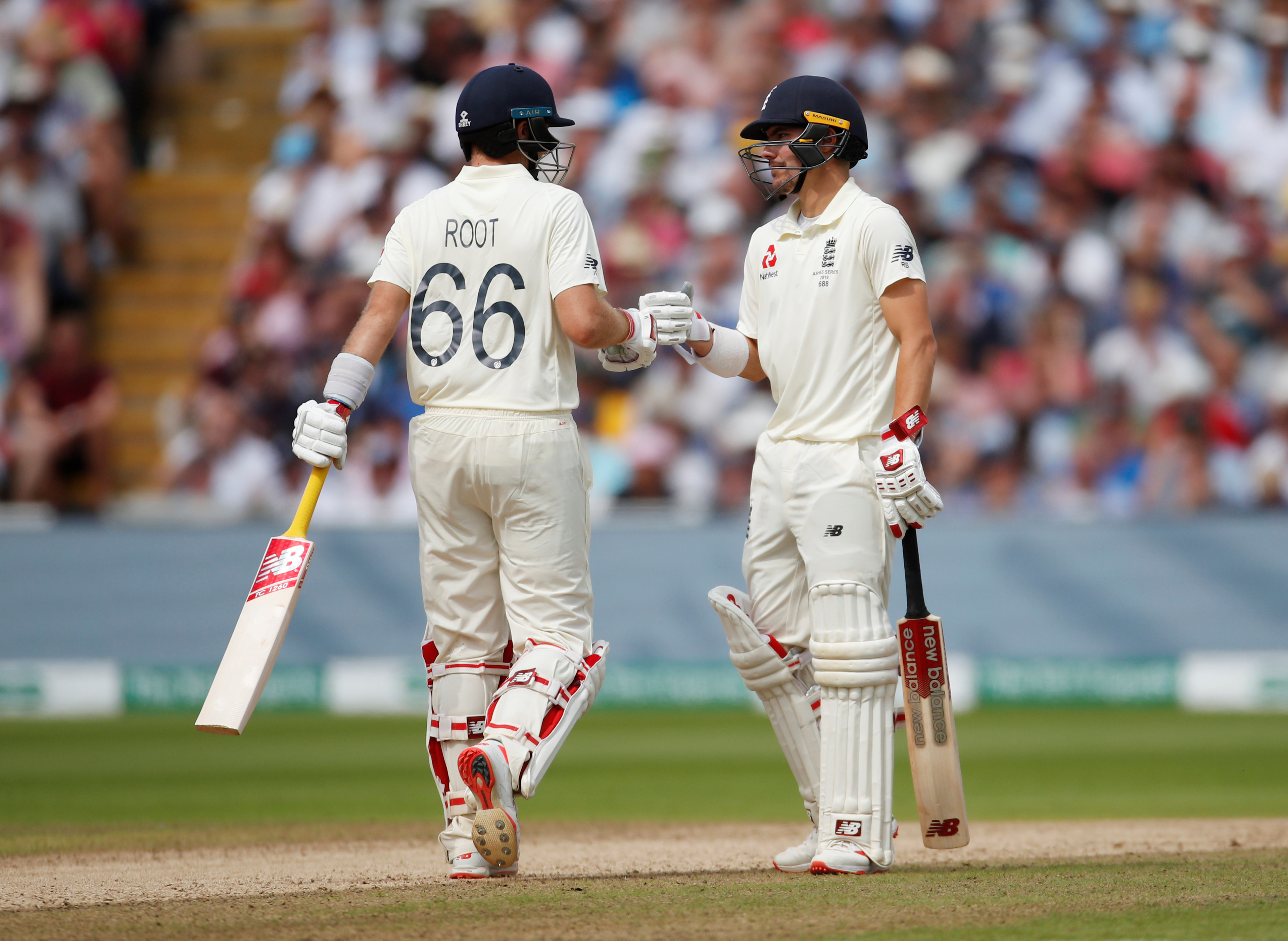 Cricket - Ashes 2019 - First Test - England v Australia - Edgbaston, Birmingham, Britain - August 2, 2019   England's Joe Root and Rory Burns touch gloves during the match   Action Images via Reuters/Andrew Boyers