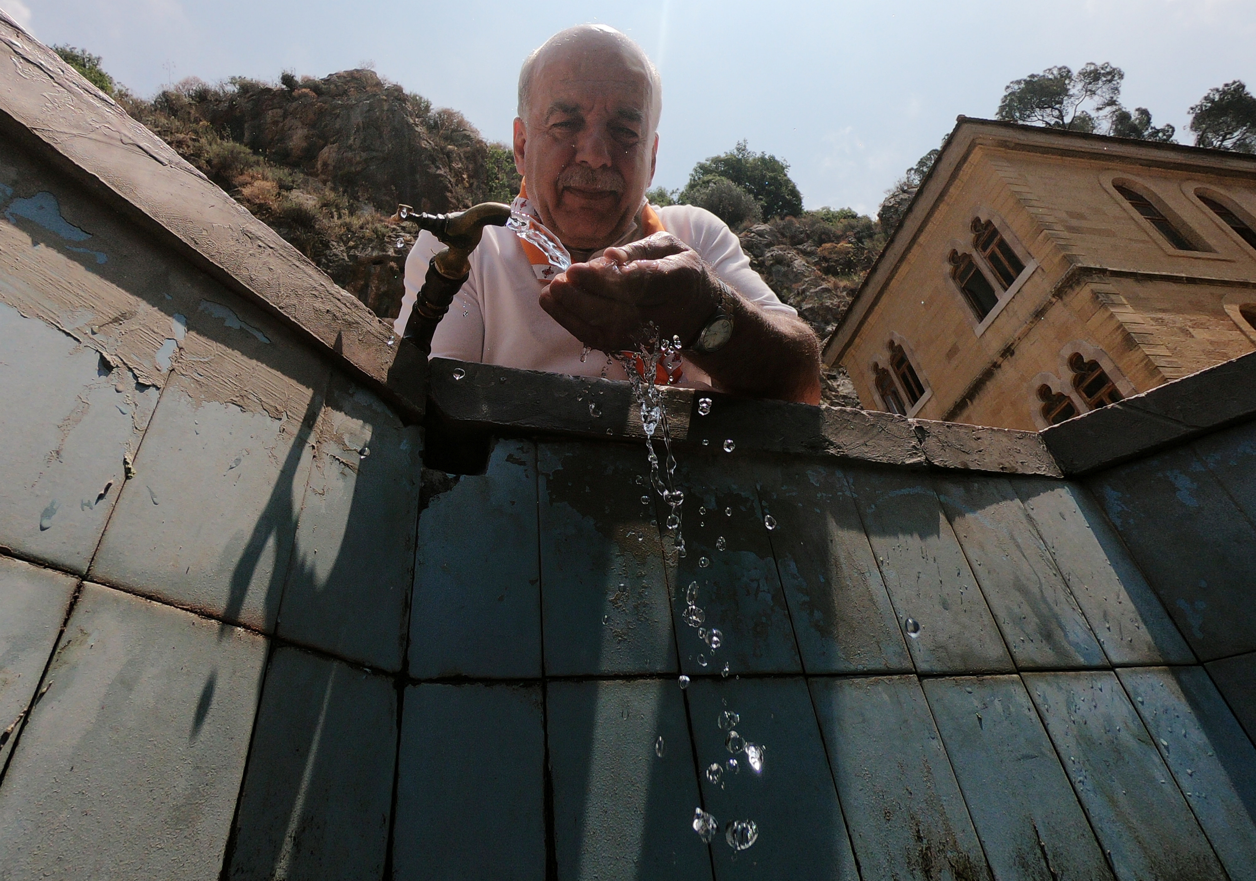 Samuel Botros drinks water at the Monastery of Saint Anthony of Qozhaya in the heart of the Qadisha valley, in Zgharta district, Lebanon June 23, 2019. Picture taken June 23 , 2019. REUTERS/Imad Creidi