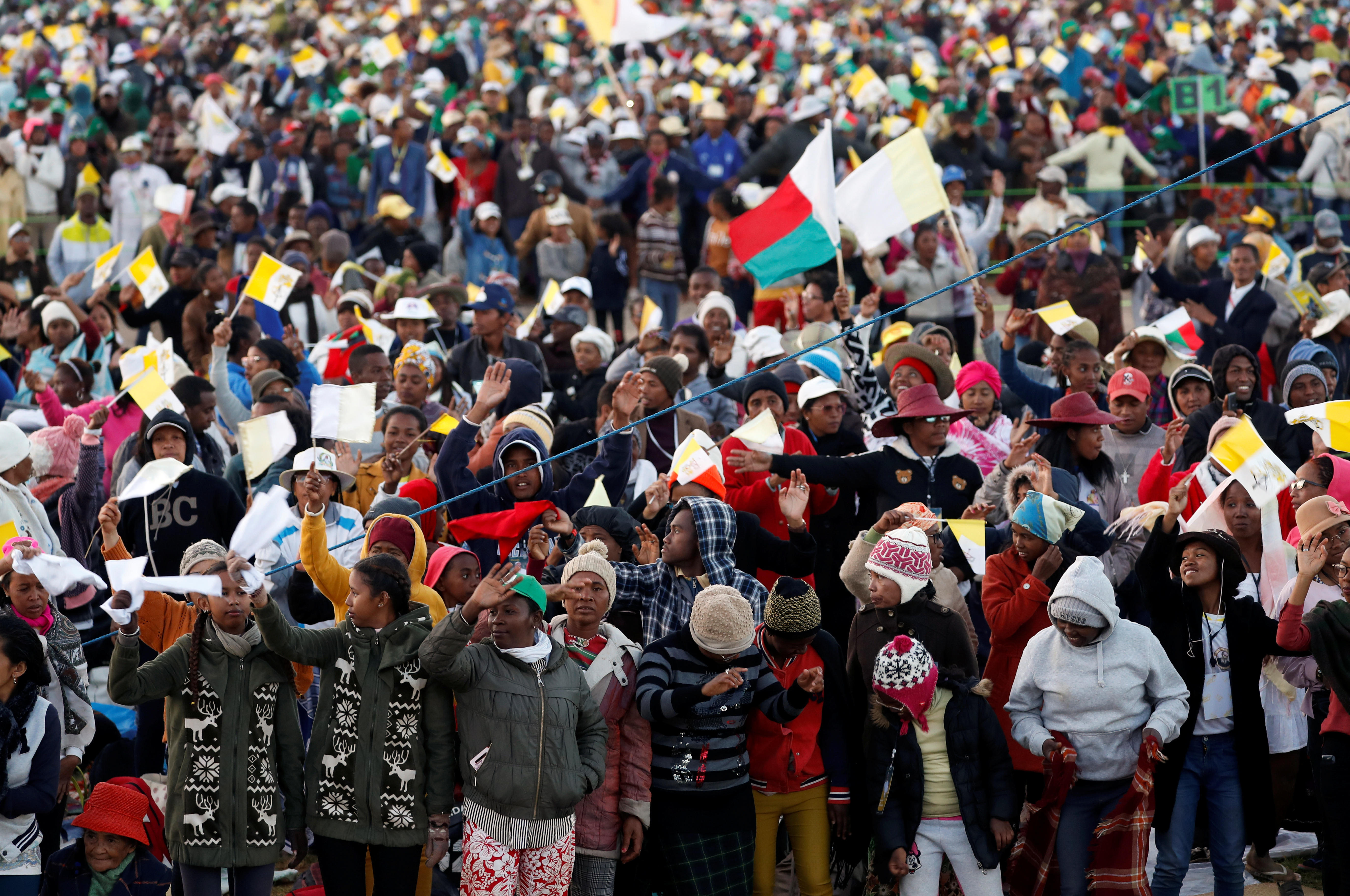 People are seen ahead of Pope Francis' arrival for a prayer vigil with youth at the Soamandrakizay Mess site in Antananarivo, Madagascar, September 7, 2019. REUTERS/Yara Nardi