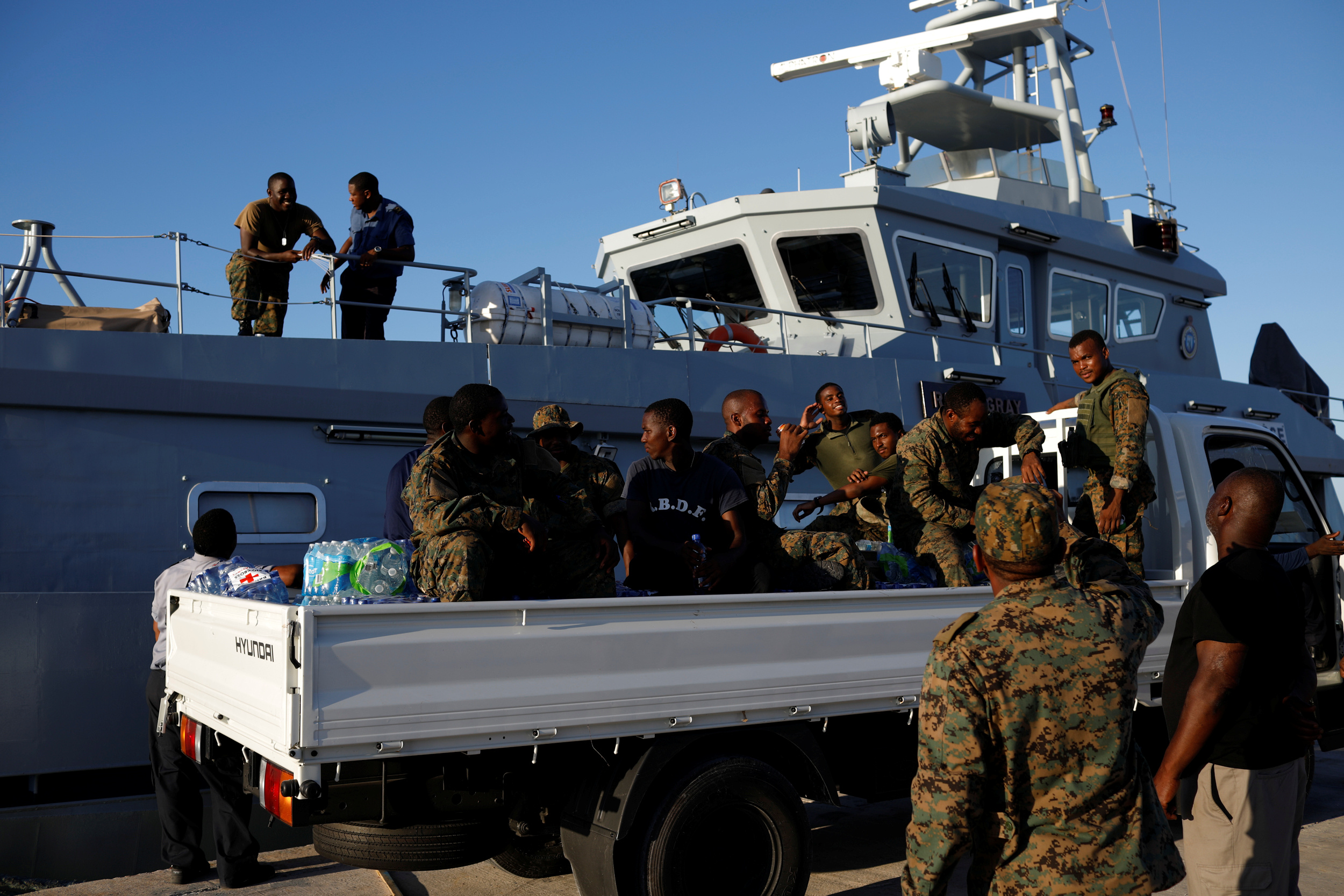 Soldiers are seen at Marsh Harbour Government Port during an evacuation operation after Hurricane Dorian hit the Abaco Islands in Marsh Harbour, Bahamas, September 6, 2019. REUTERS/Marco Bello