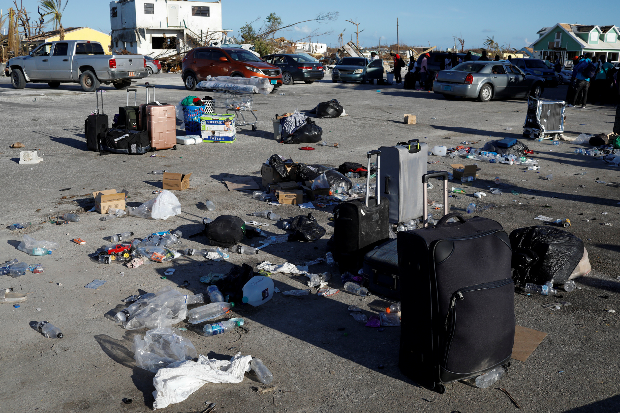 Suitcases, bags and trash are seen at Marsh Harbour Government Port during an evacuation operation after Hurricane Dorian hit the Abaco Islands in Marsh Harbour, Bahamas, September 6, 2019. REUTERS/Marco Bello