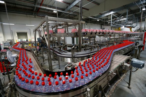 FILE PHOTO: Bottles of Evian water, part of Danone group, are pictured in the new bottling plant during the official opening ceremony in Publier near Evian-les-Bains, France September 12, 2017. REUTERS/Denis Balibouse/File Photo
