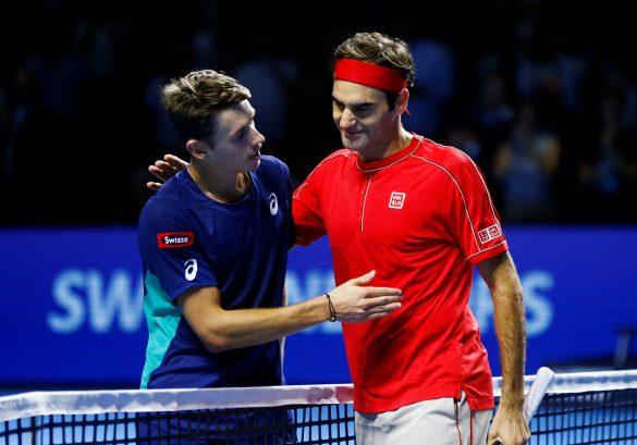 Tennis - ATP 500 - Swiss Indoors Basel - St. Jakobshalle, Basel, Switzerland - October 27, 2019   Switzerland's Roger Federer with Australia's Alex de Minaur after winning the final   REUTERS/Arnd Wiegmann