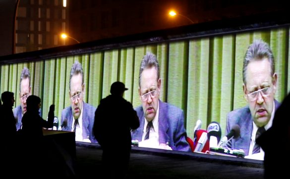 FILE PHOTO: Historic video footage from former official of the Socialist Unity Party of Germany Guenter Schabowski is projected during a rehearsal with 3D video beamers on the East Side Gallery, the largest remaining part of the former Berlin Wall, in Berlin, Germany, November 3, 2019. REUTERS/Fabrizio Bensch/File Photo