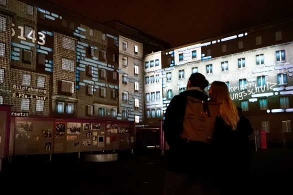 People stand in front of a projection on the former Stasi secret police headquarters in Berlin, Germany, November 4, 2019. On November 9th Germany will mark the 30th anniversary of the fall of the Berlin Wall (Berliner Mauer) in 1989. REUTERS/Fabrizio Bensch