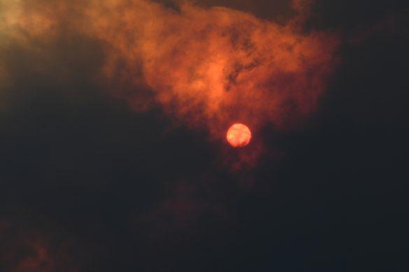 The sun is seen through heavy smoke as a bushfire burns in Woodford NSW, Australia, November 8, 2019. AAP Image/Dan Himbrechts/via REUTERS